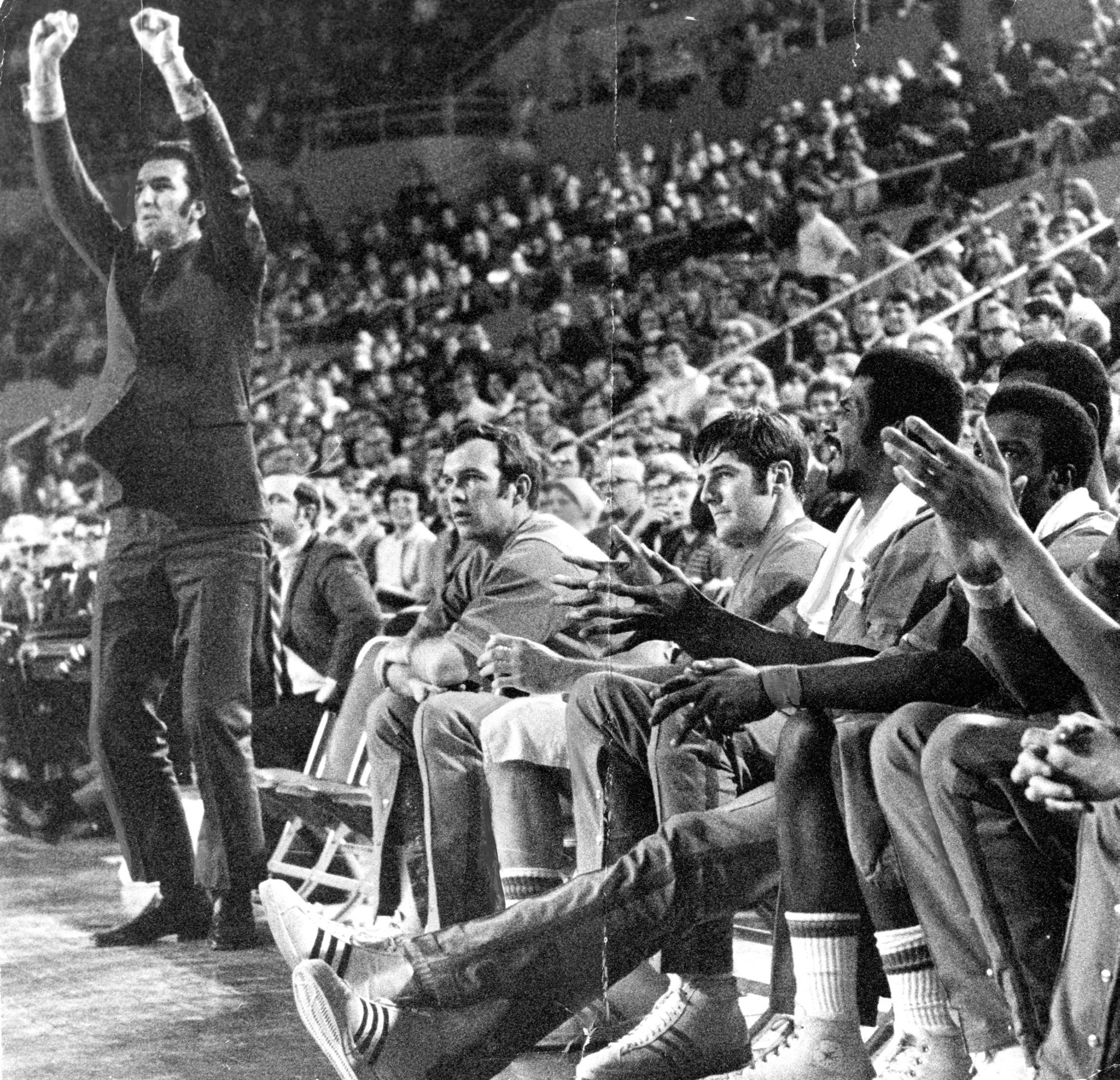Dolph Schayes gives signals to his team during the Buffalo Braves' 97-91 win over the New York Knicks at Memorial Auditorium in 1970. Schayes died Thursday at age 87.
