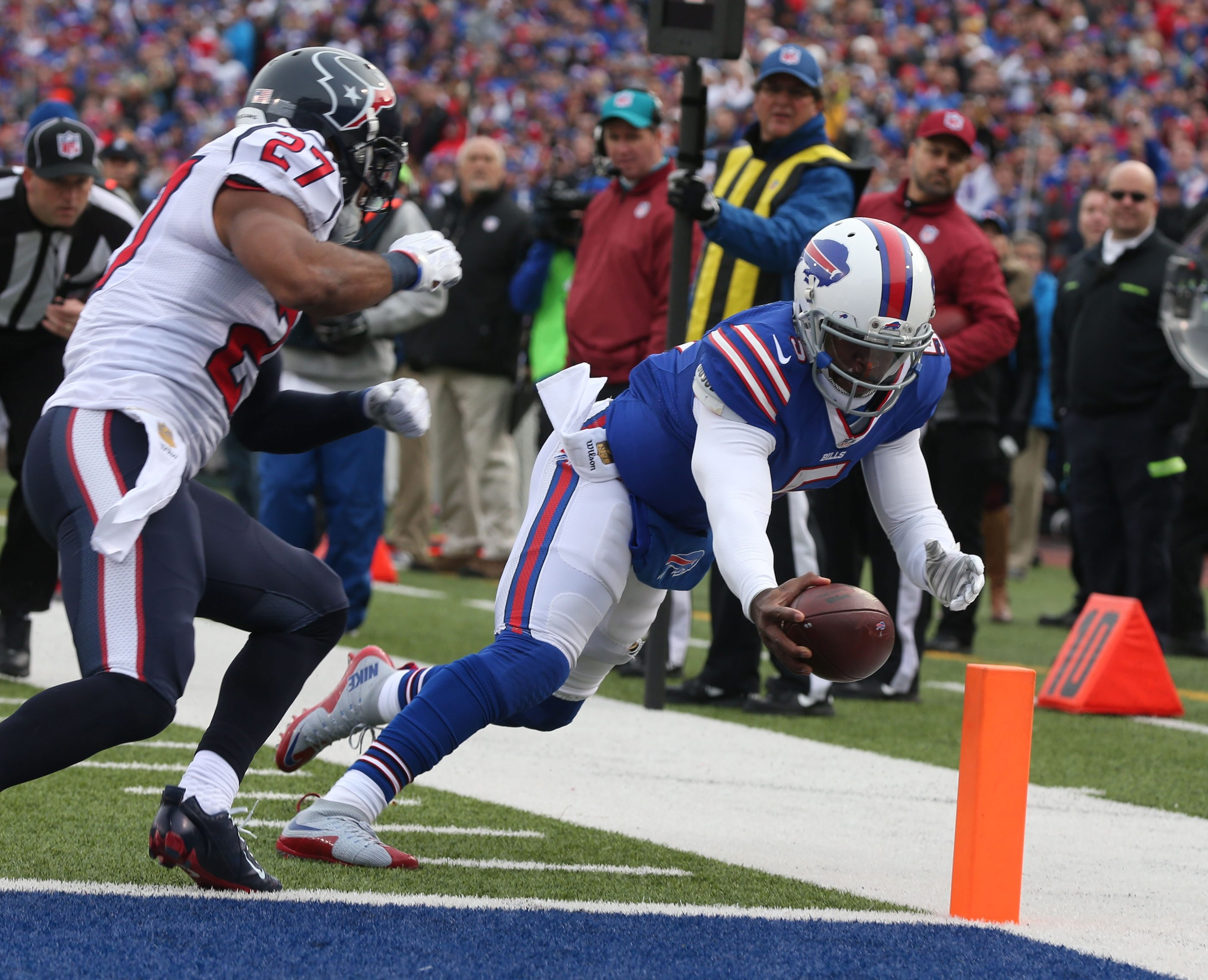 Buffalo Bills quarterback Tyrod Taylor (5) dives into the end zone for a touchdown under pressure from Houston Texans safety Quintin Demps (27) during the second quarter at Ralph Wilson Stadium in Orchard Park, N.Y. on Sunday, Dec. 6, 2015.  (James P. McCoy/ Buffalo News)