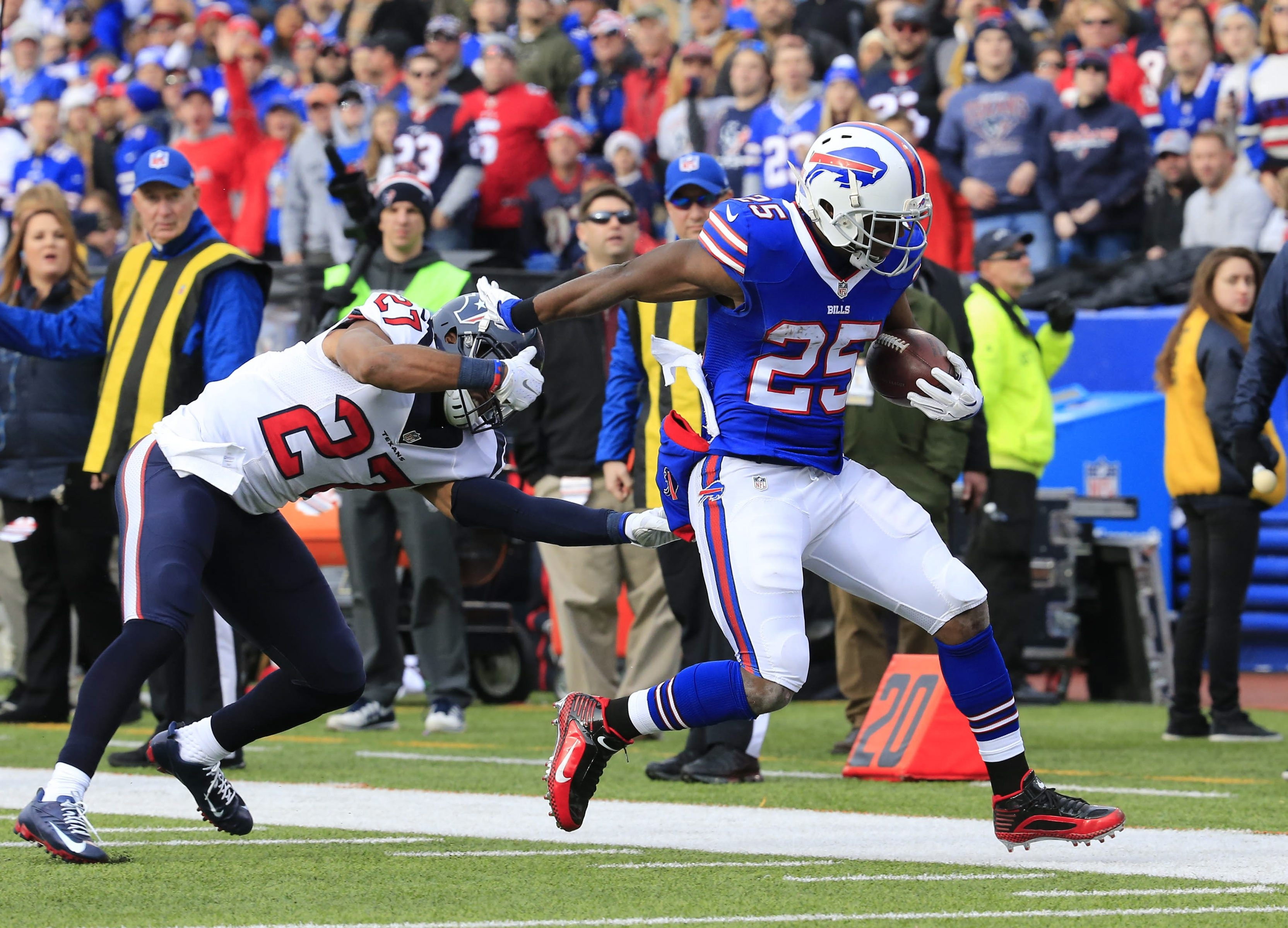 Bills running back LeSean McCoy gets pushed out of bounds by Texans safety Quintin Demps in the first quarter. McCoy racked up 112 rushing yards for the third time this season.