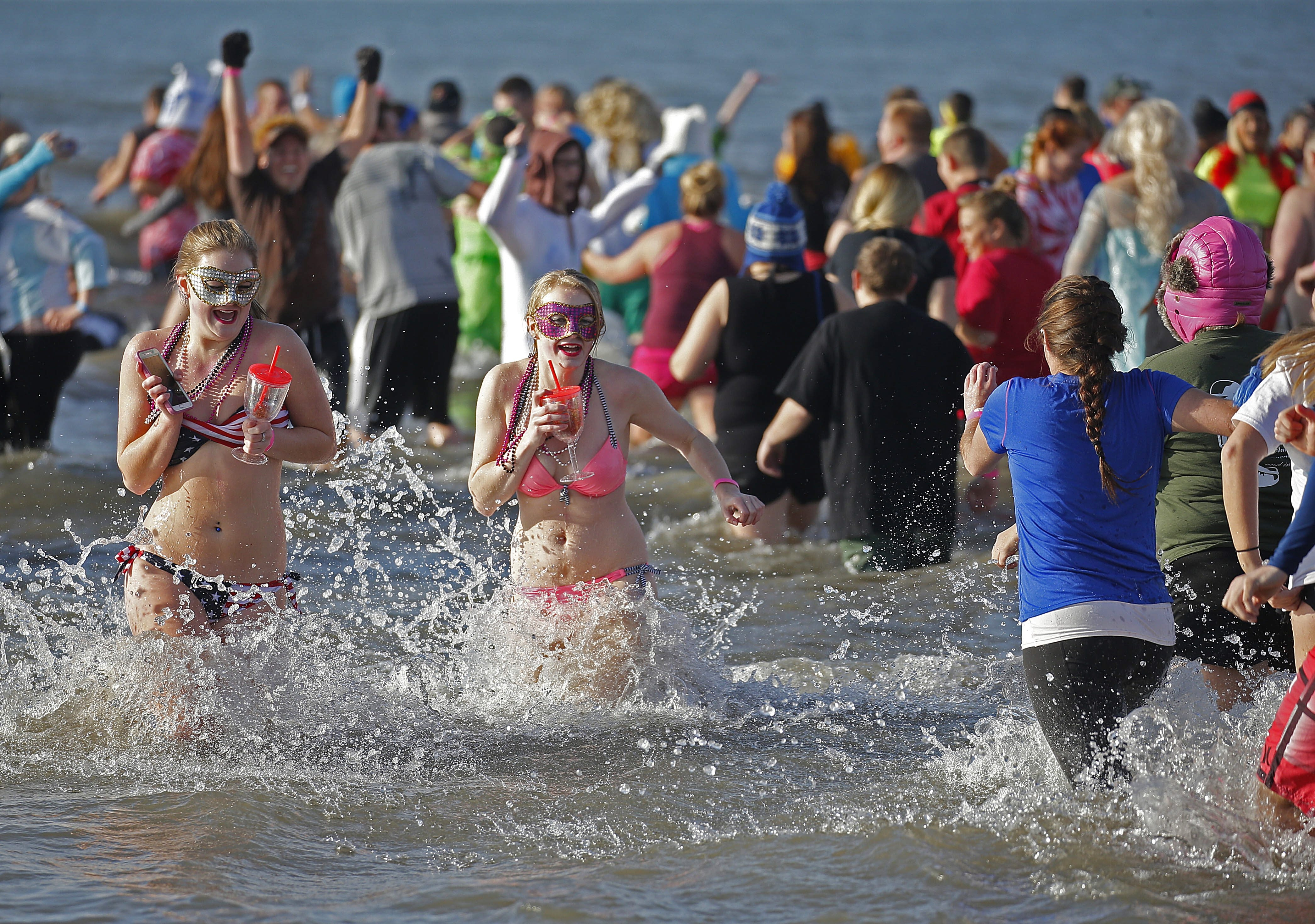 Saturday was a perfect day for silly hats and crazy costumes during the Polar Plunge at Woodlawn Beach on Lake Erie.