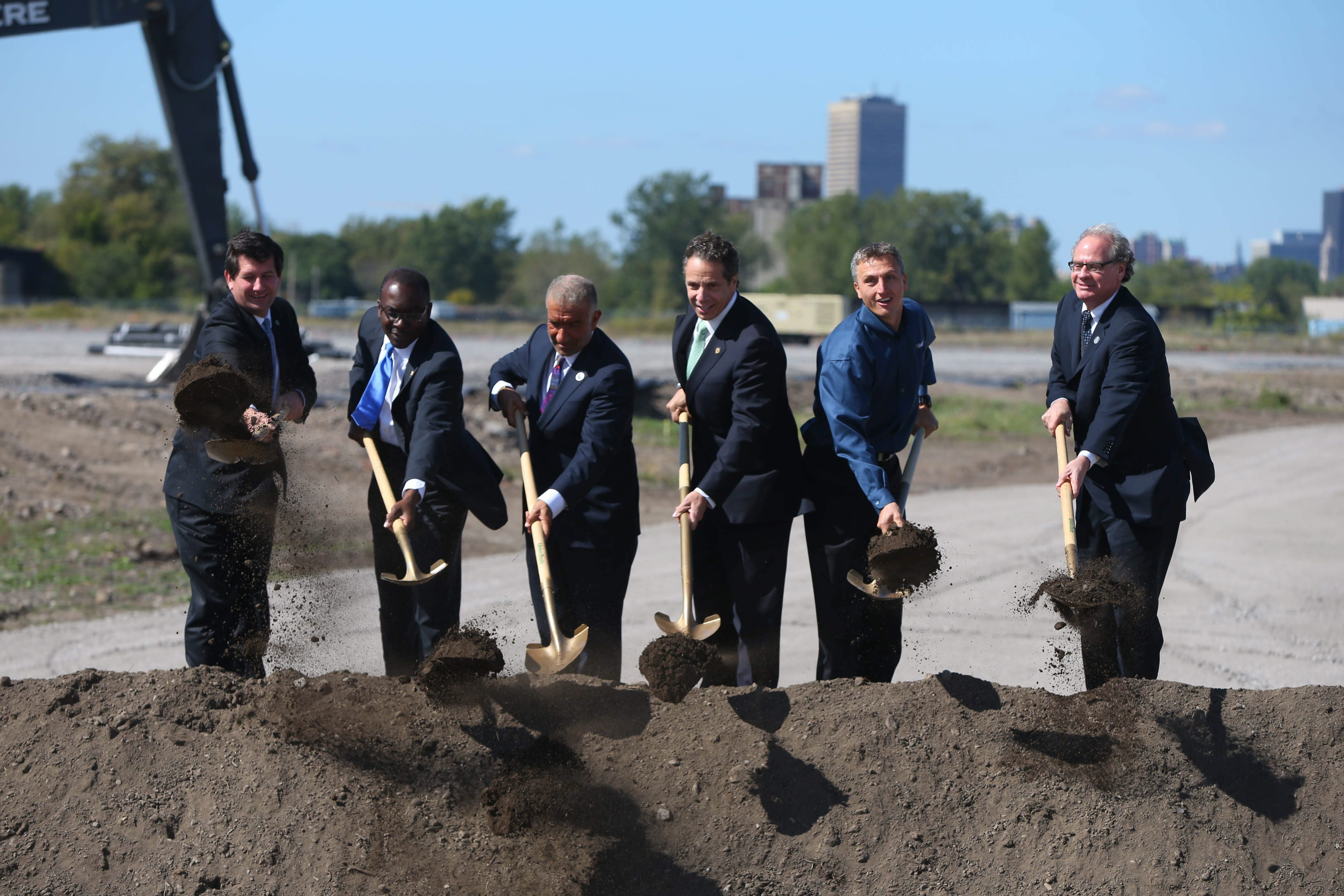 From left to right: County Exec. Mark Poloncarz, Mayor Byron Brown, Dr. Alain E. Kaloyeros, Gov. Andrew Cuomo, SolarCity CEO Lyndon Rive, and Howard Zemsky throw ceremonial shovels of dirt  during the announcement of the Riverbend project in South Buffalo Tuesday, September 23, 2014.  (Mark Mulville/Buffalo News)