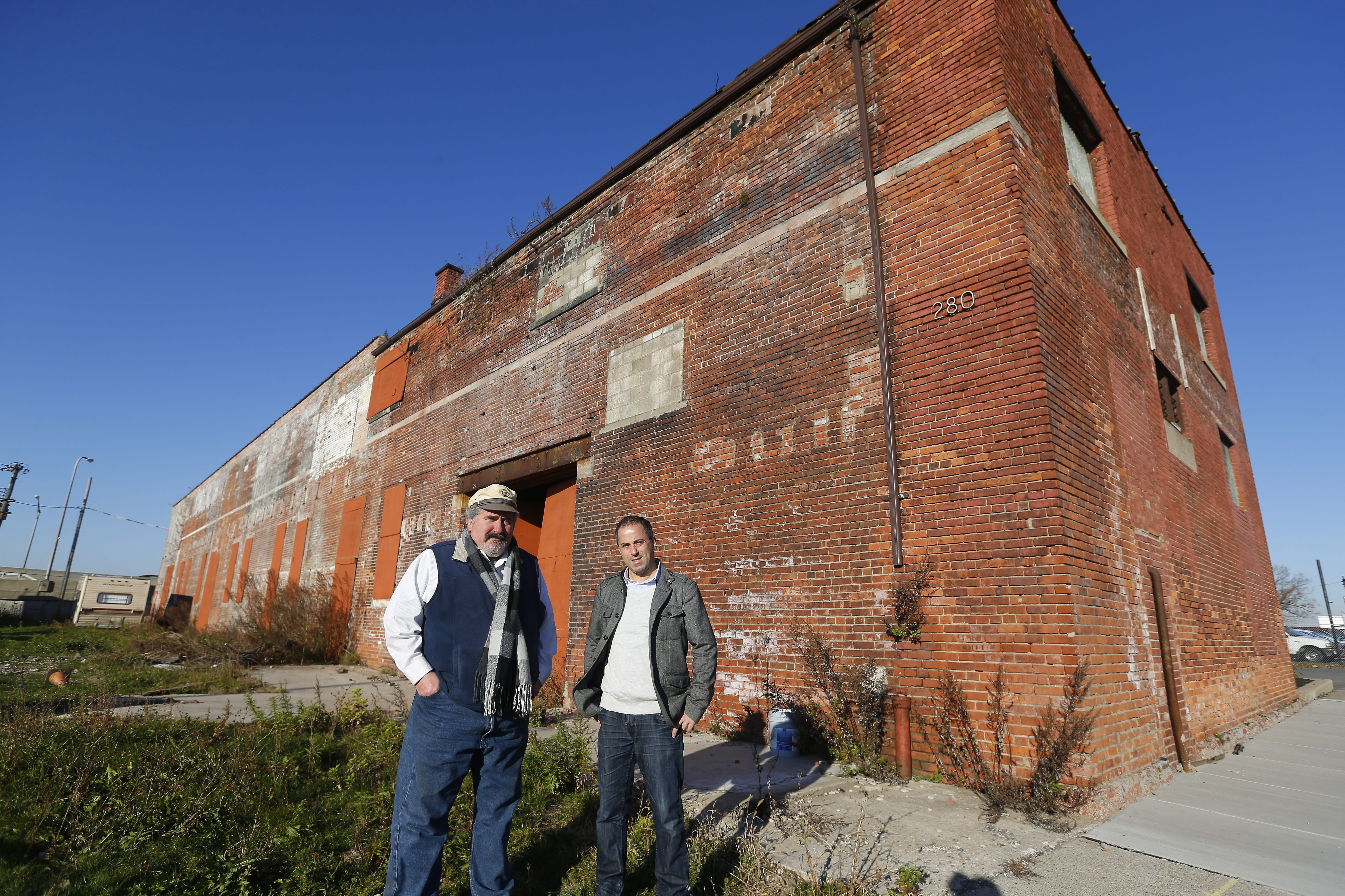 "Paul Tsouflidis, right, and Bill Zimmerman plan to restore the ""Terminal A"" building on Niagara Street into a museum, brewery and restaurant honoring Nikola Tesla.      Mark Mulville/Buffalo News"