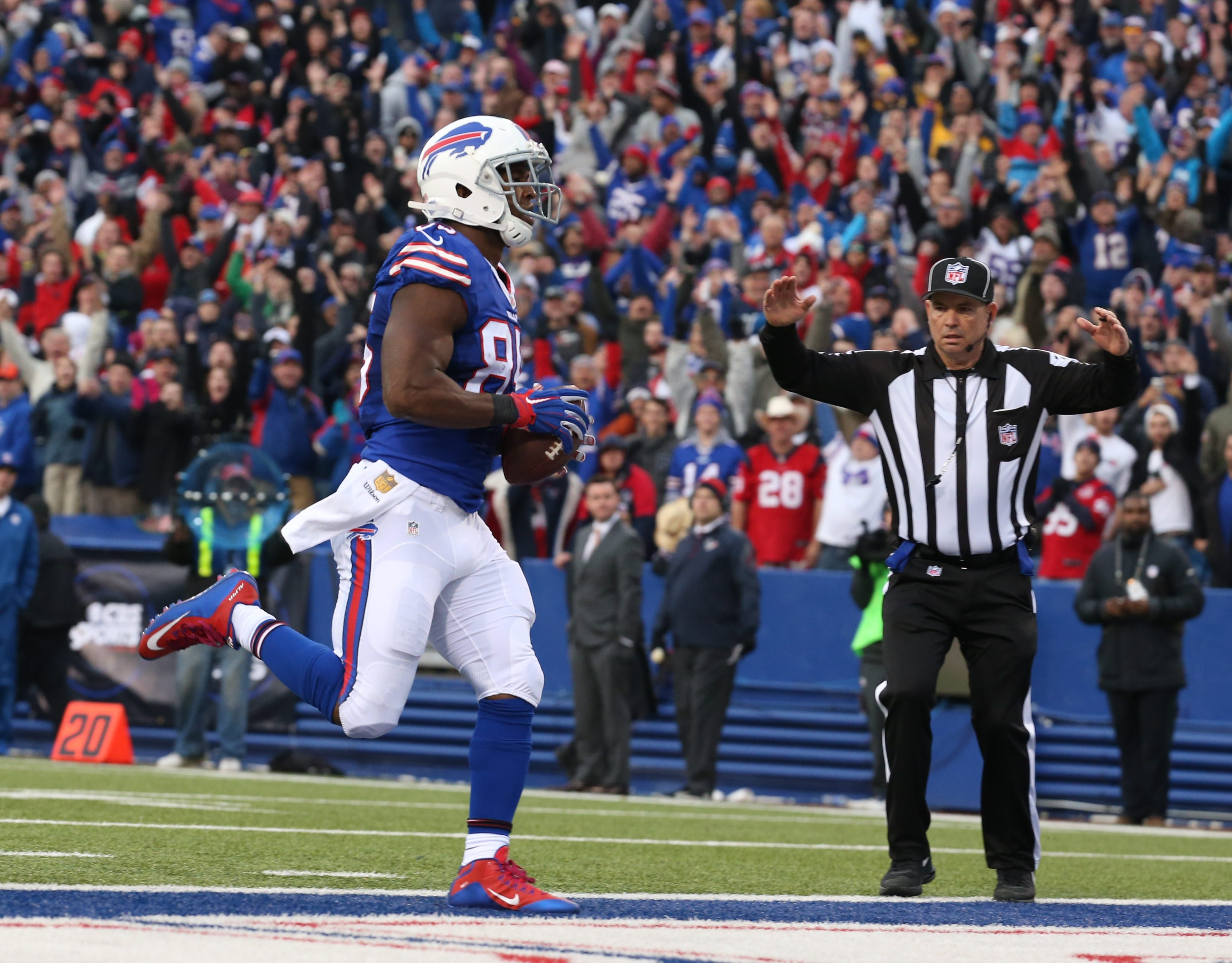 The Bills' Charles Clay waltzes into the end zone unguarded for what proved to be the game-clinching points in the fourth quarter against Houston.