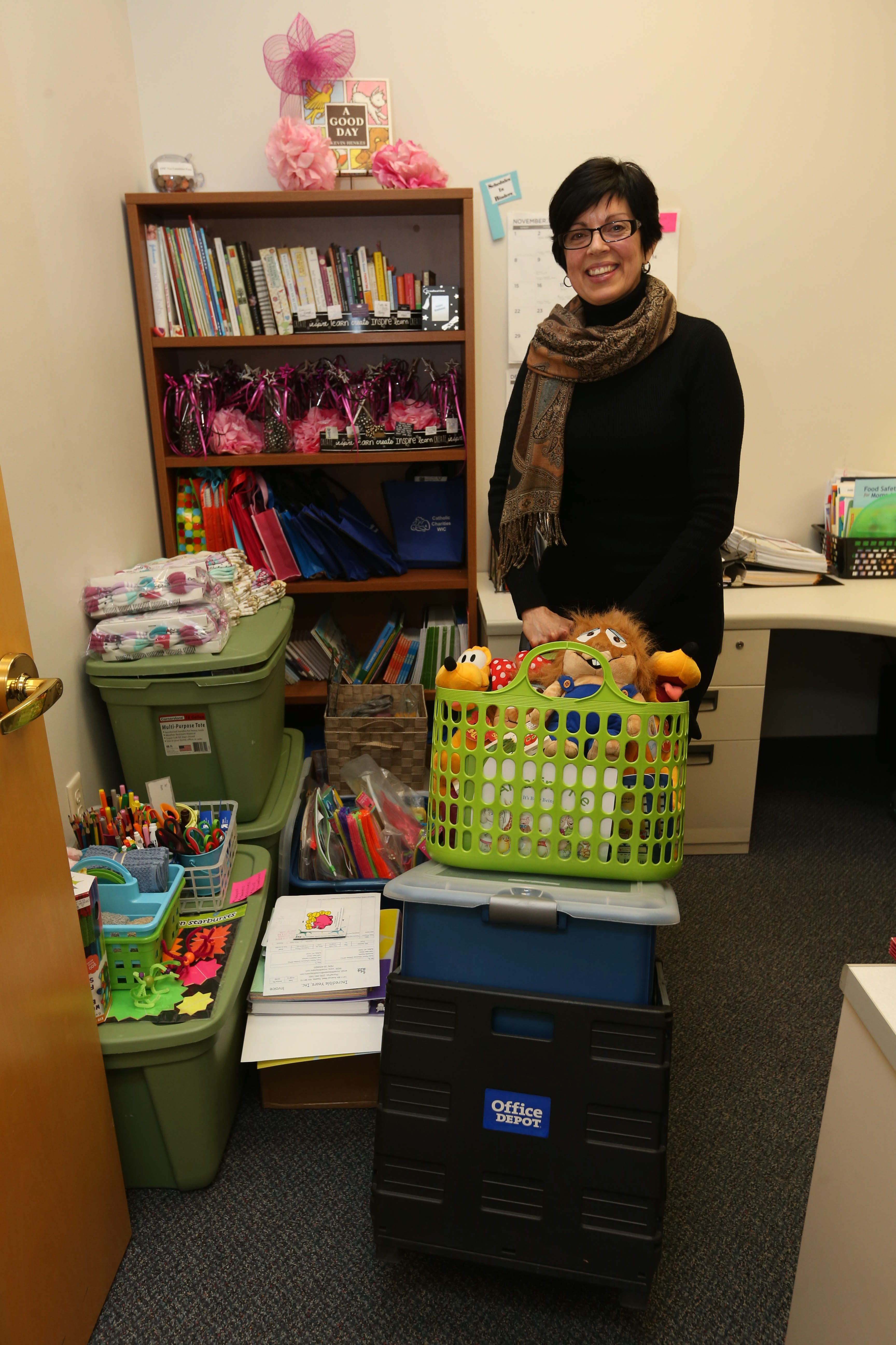 """""""The way you talk to your children now will help you in the long run."""" – Madeline Gathers, EPIC program director, seen in her office, which is filled with supplies for several of the programs she runs."""