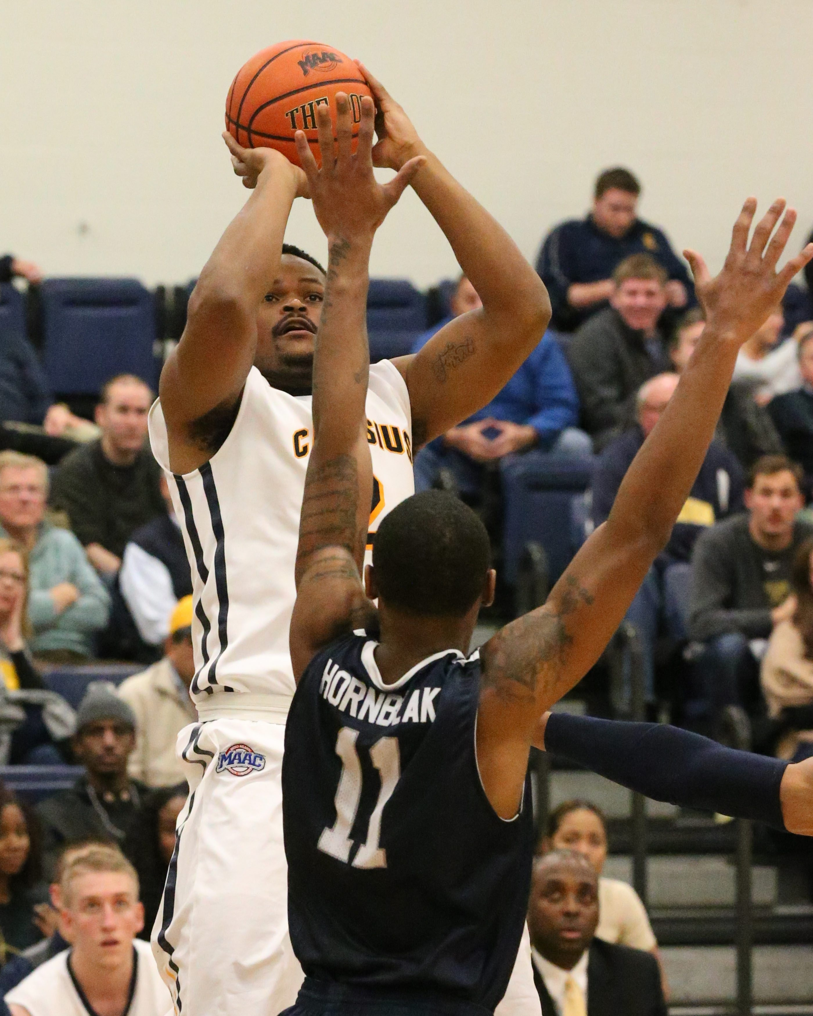 Canisius forward Jermaine Crumpton takes a shot on Monmouth guard Je'lon Hornbeak in the second half.