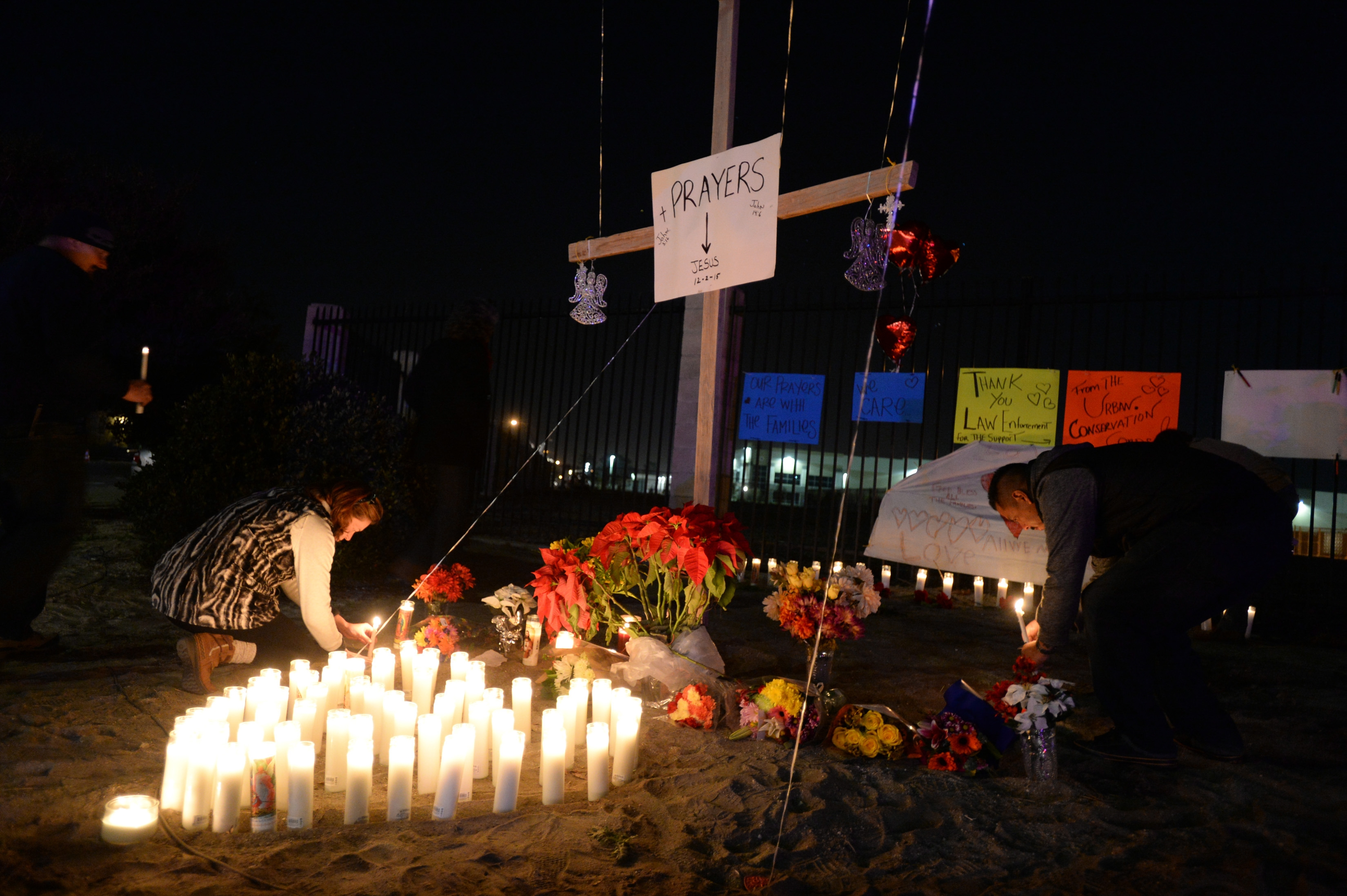 Mourners add to a memorial outside the Inland Regional Center, the scene a mass shooting that left 14 dead the day before, in San Bernardino, Calif., Dec. 3, 2015. Struck down at an office holiday party for county employees, almost all the victims were friends and colleagues, and many knew one of the two suspected gunmen, Syed Rizwan Farook, a co-worker. (Axel Koester/The New York Times)