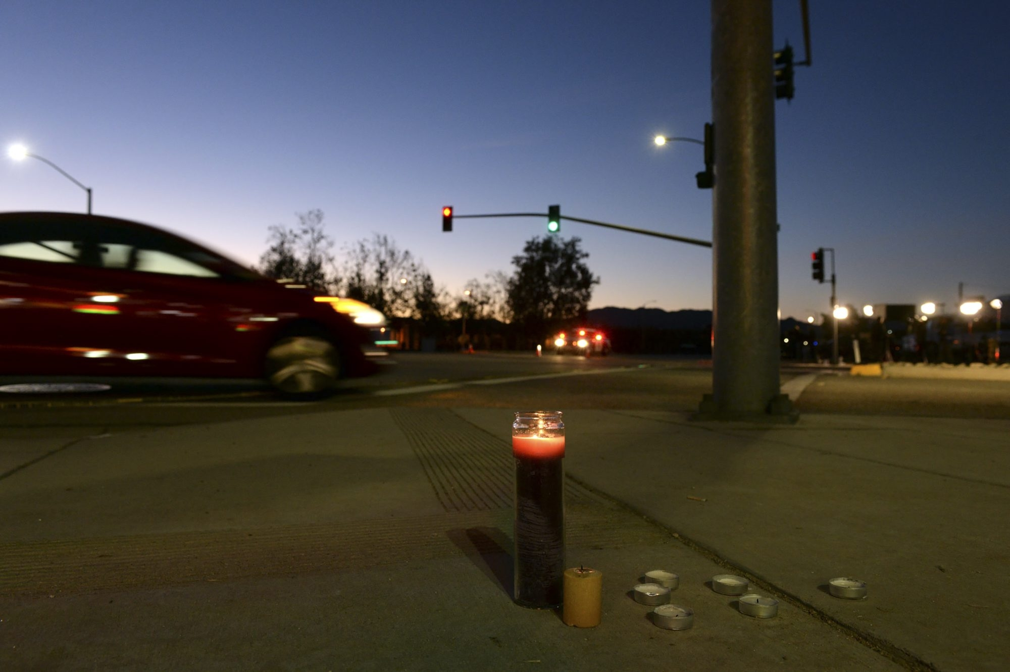 A makeshift memorial near where police have established a perimeter for the mass shooting at the Inland Regional Center in San Bernardino, Calif., on Dec. 3. (The New York Times)