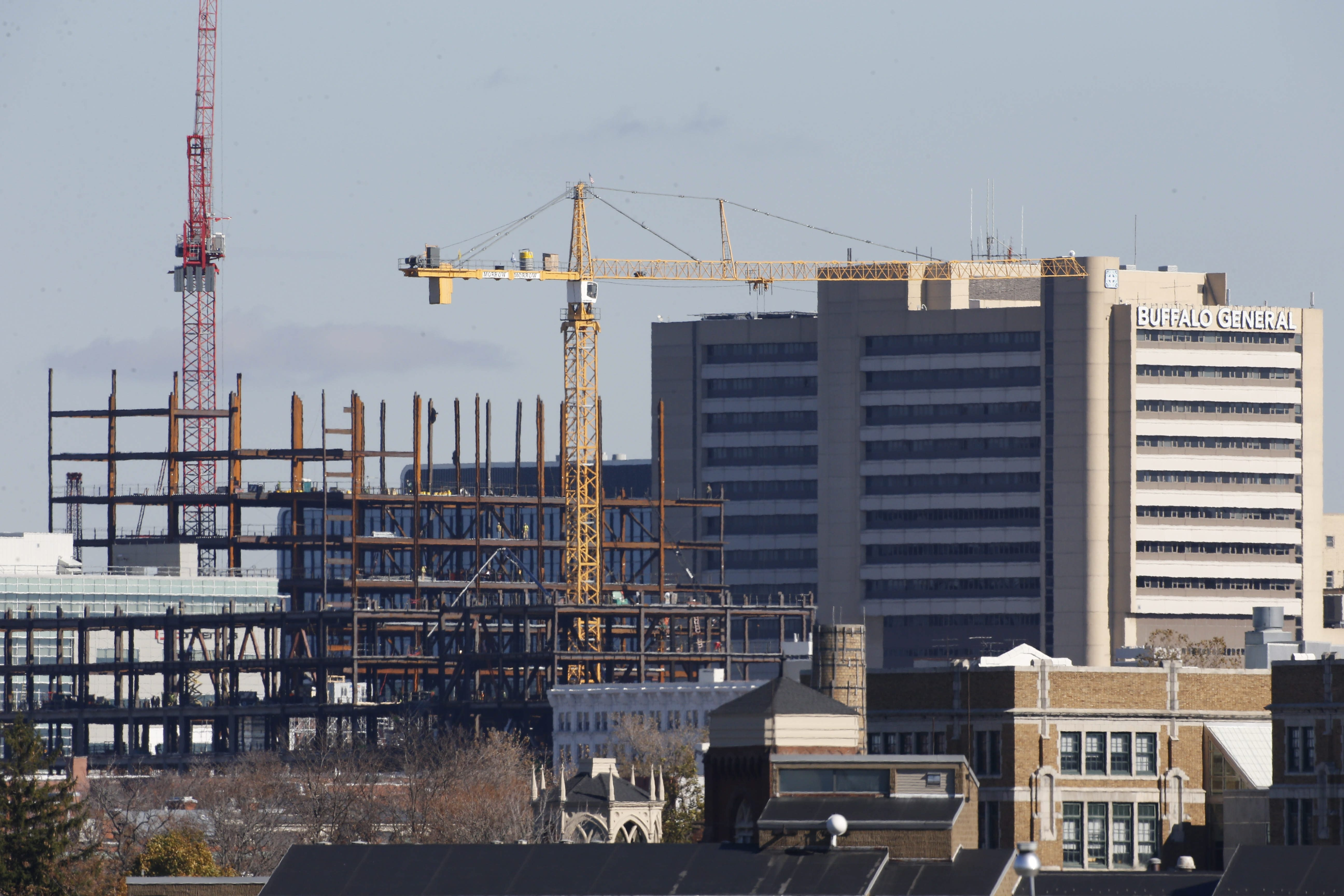 The new John R. Oishei Children's Hospital, shown here being built last month, will be topped off Monday with the final steel piece of its frame.   (Derek Gee/Buffalo News)