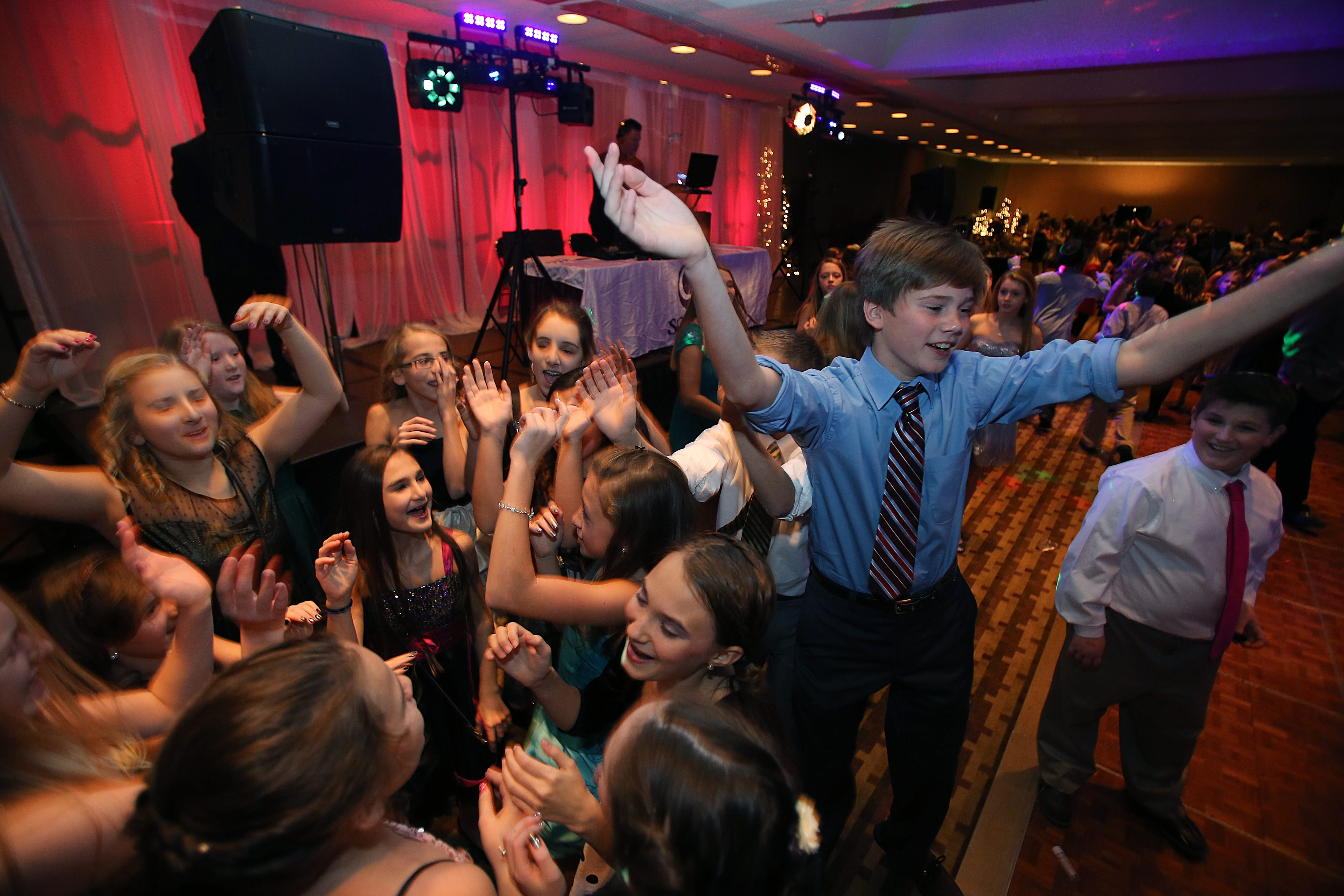 Students from area schools dance during the annual Maria M. Love Charity Ball in 2012. The dance raises money for people in need.