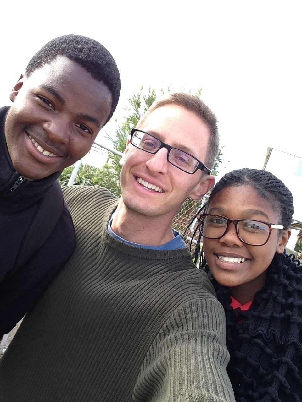 Jason Torreano, center, founded a program for South African youth like Thembisile, left, and Selunathi.