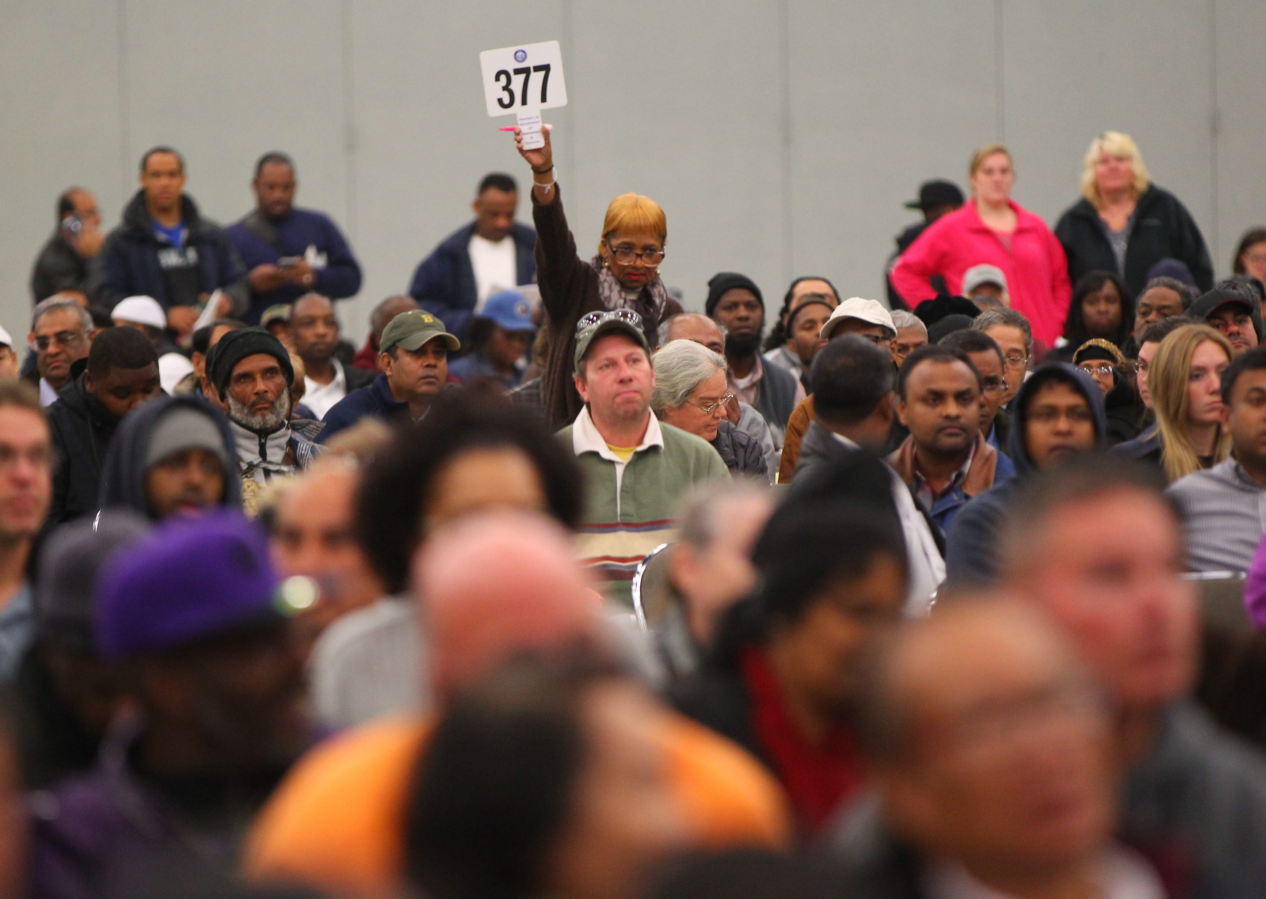 People bid on property during an auction held at the Buffalo Niagara Convention Center on Oct. 27, 2015. A bill sponsored by State Sen. Timothy M. Kennedy and Assemblyman Sean M. Ryan has been amended to require the city to notify the foreclosed property owners that the money belongs to them. (Mark Mulville/Buffalo News)