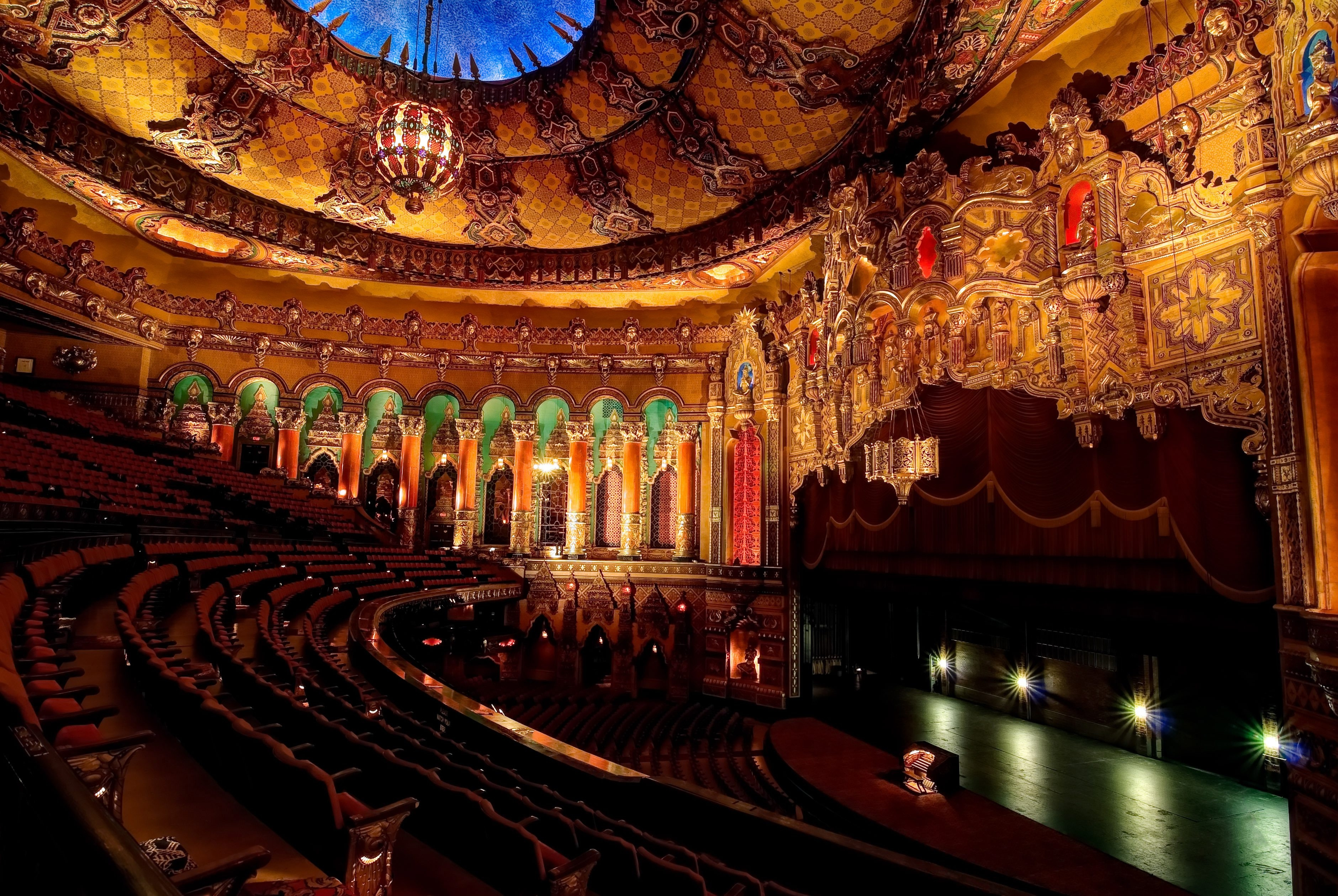 Amid its opulent decor, the refurbished Detroit Fox Theatre boasts more than 5,000 seats, a six-story grand lobby, a chandelier of colored glass and decorative columns.