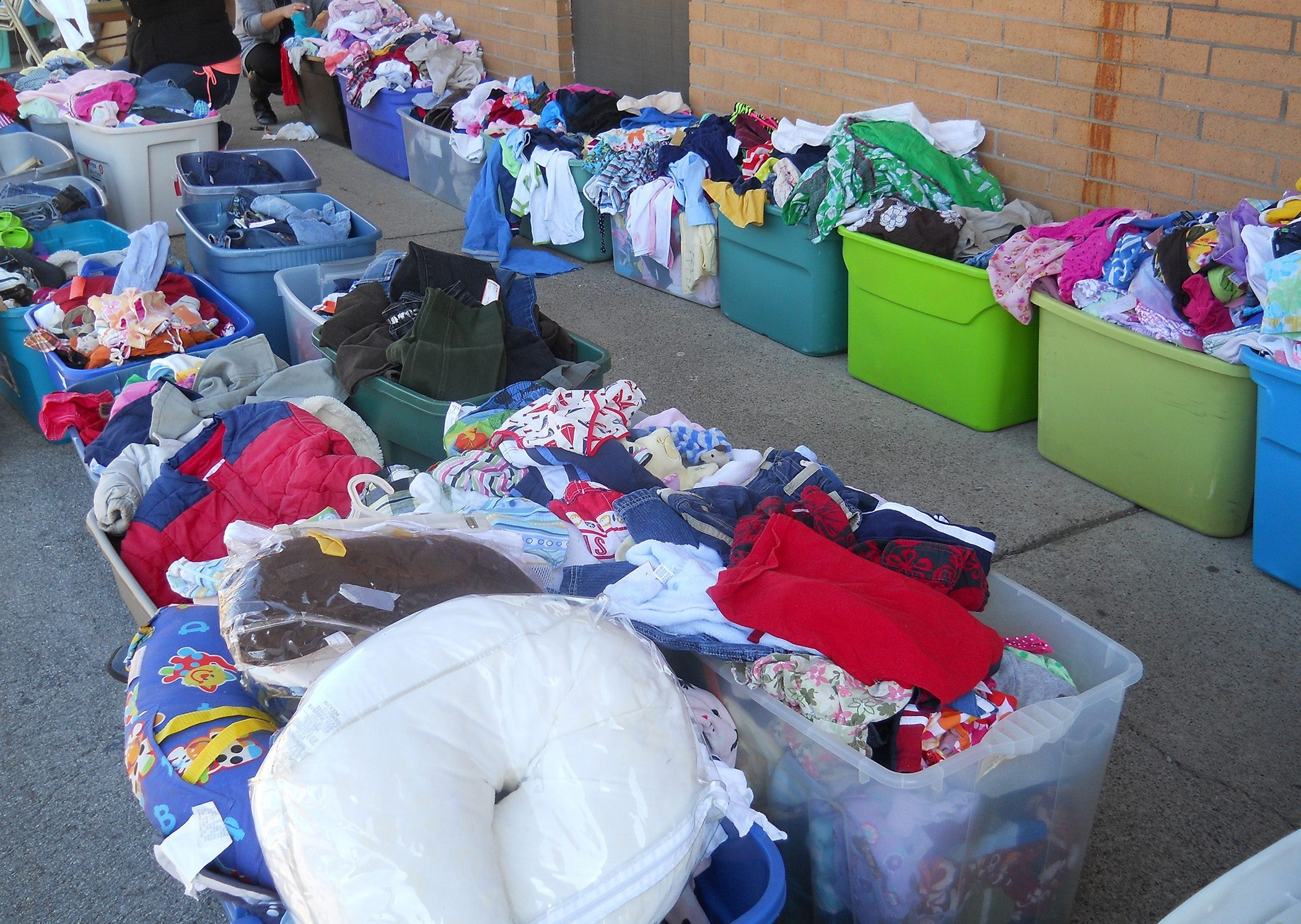 Boy Scout Troop 824 helped sort through boxes of children's clothing at Lollipop Loft to donate to Community Missions.
