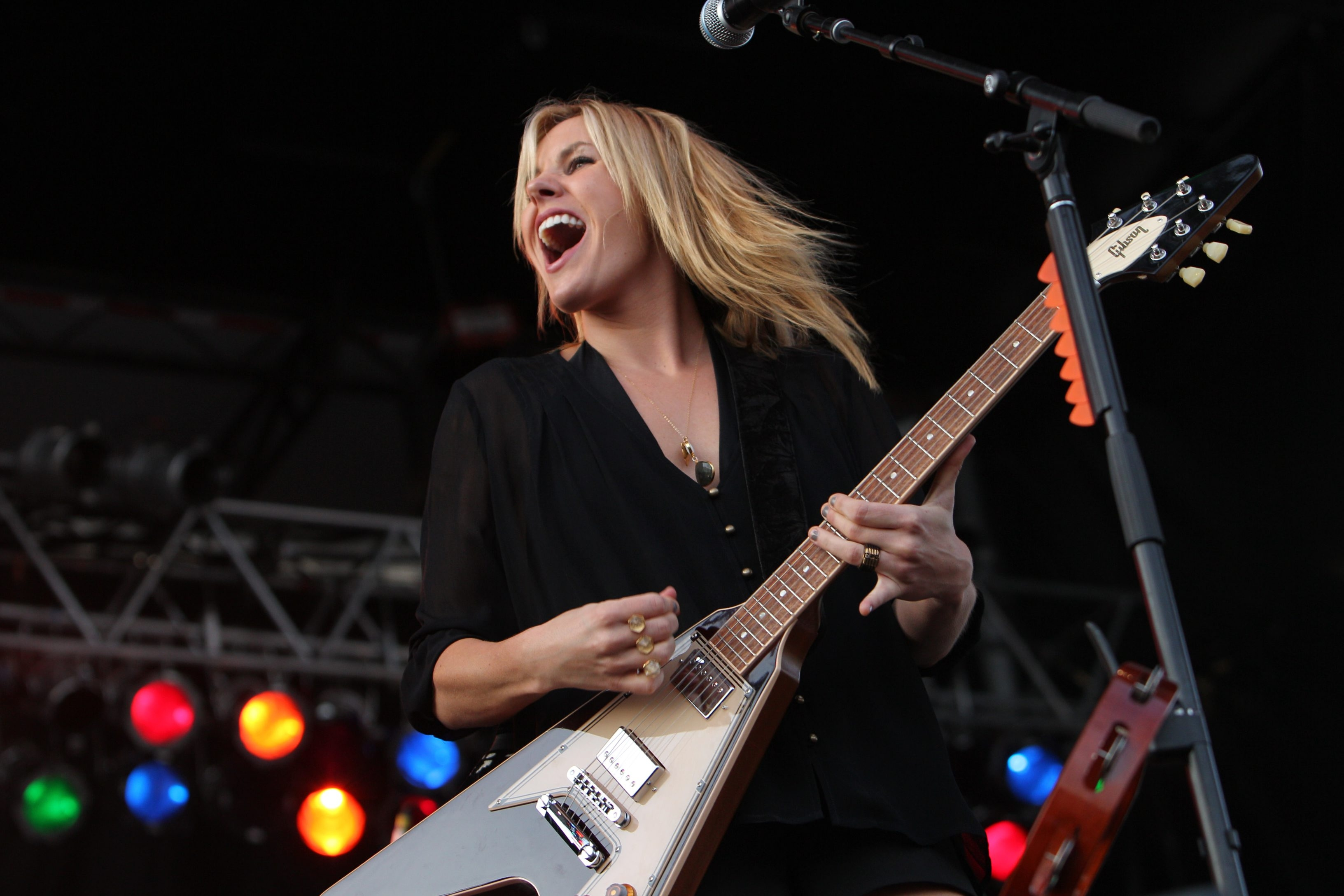 """Grace Potter, her band and their music are much in demand. """"We'll play about 180 concerts this year,""""  Potter said.  """"For me, glamour is not a job, it's a choice. You have to strike the right balance between the music and the glamour. If you do it right, it can really work to your advantage."""" – Grace Potter"""