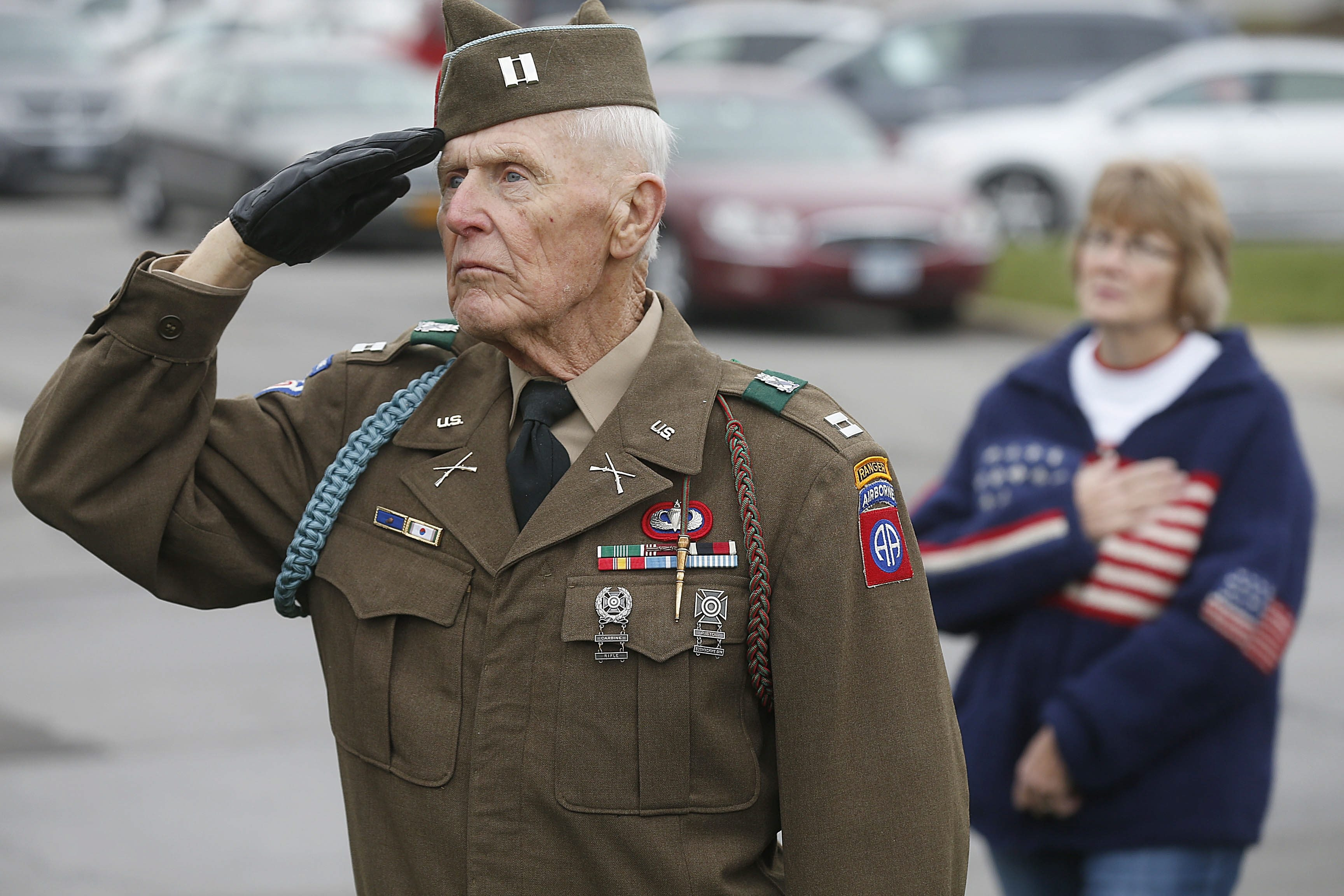 Former Army Capt. Gerald Nolan, 81, of Town of Tonawanda, who served in 82nd Airborne, salutes at Pearl Harbor event.