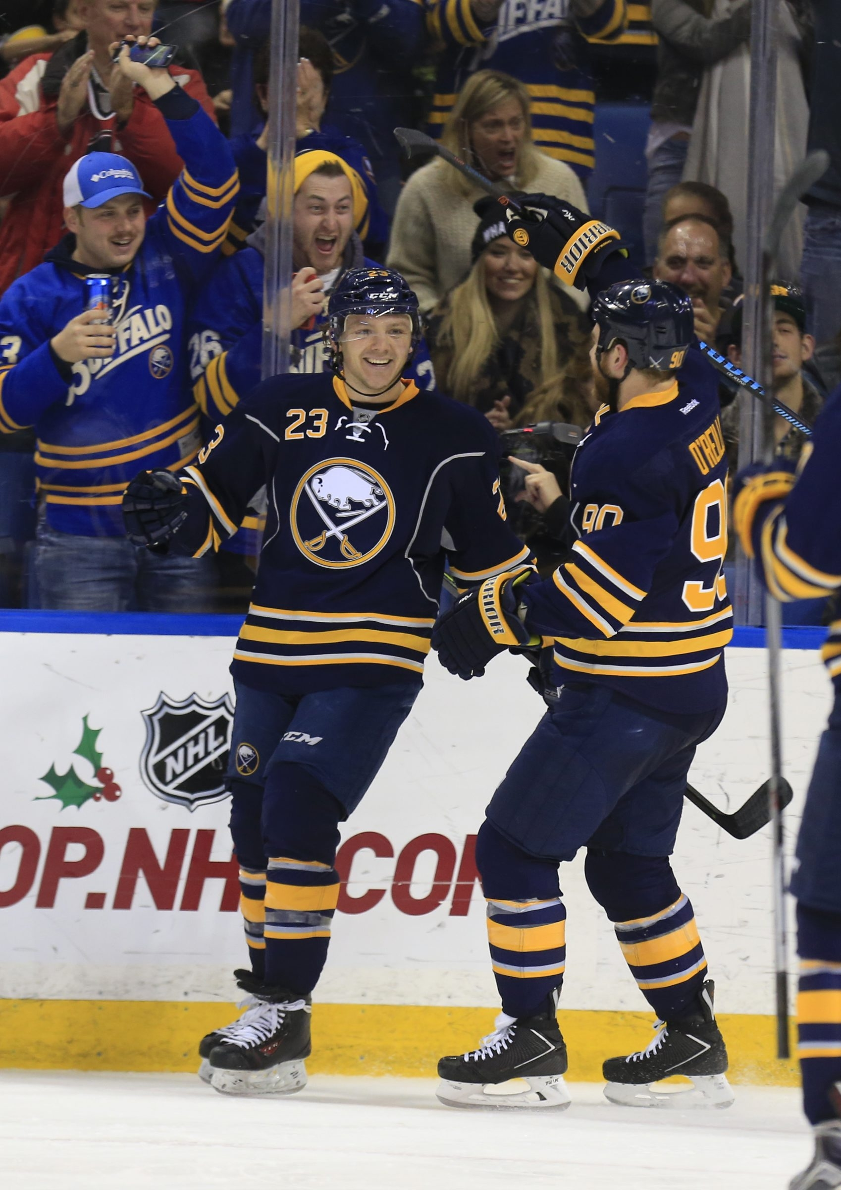 Bufalo Sabre Sam Reinhart celebrates his goal with Ryan O'Reilly against the Arizona Coyotes during second period action at the First Niagara Center on Friday, Dec. 4, 2015. (Harry Scull Jr./Buffalo News)
