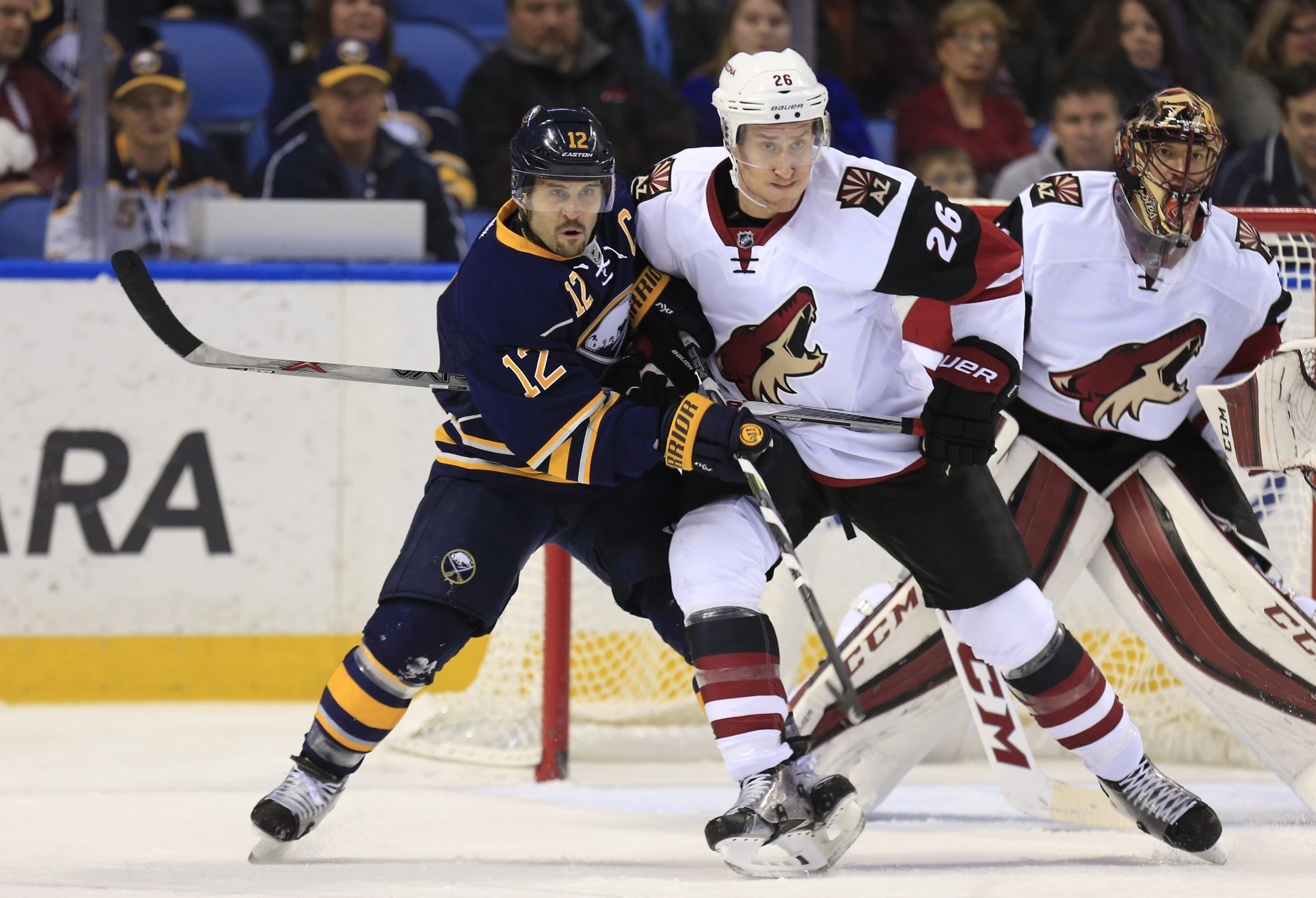 Brian Gionta, holding off Arizona Coyote Michael Stone, can make up for the defensive lapses of others.