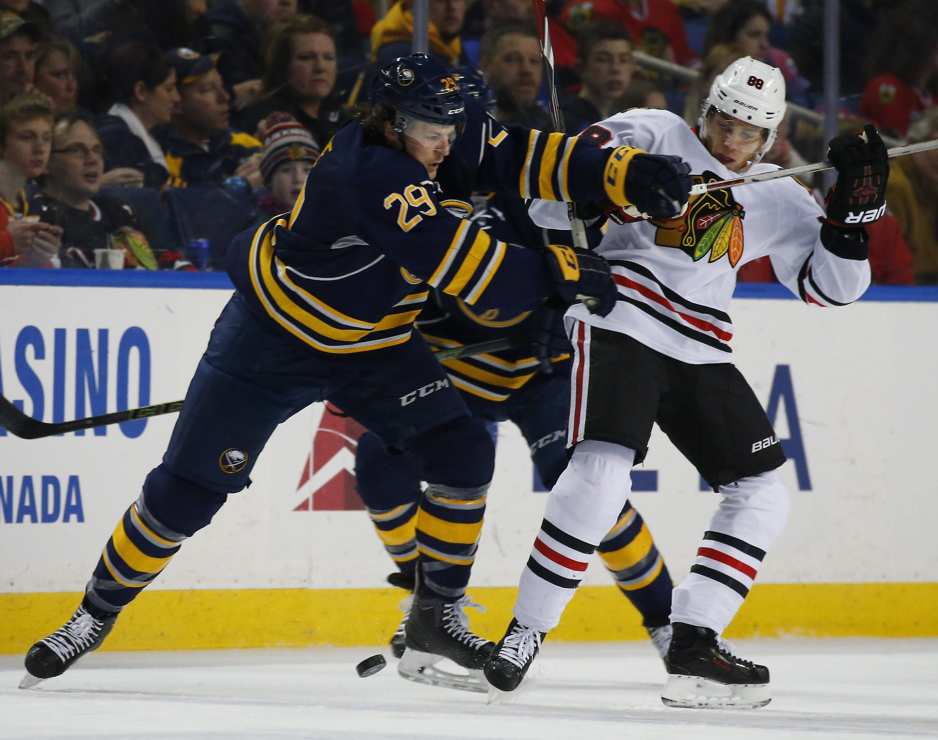 Sabres defenseman Jake McCabe keeps the Blackhawks' Patrick Kane away from the puck during Saturday afternoon's game at First Niagara Center.