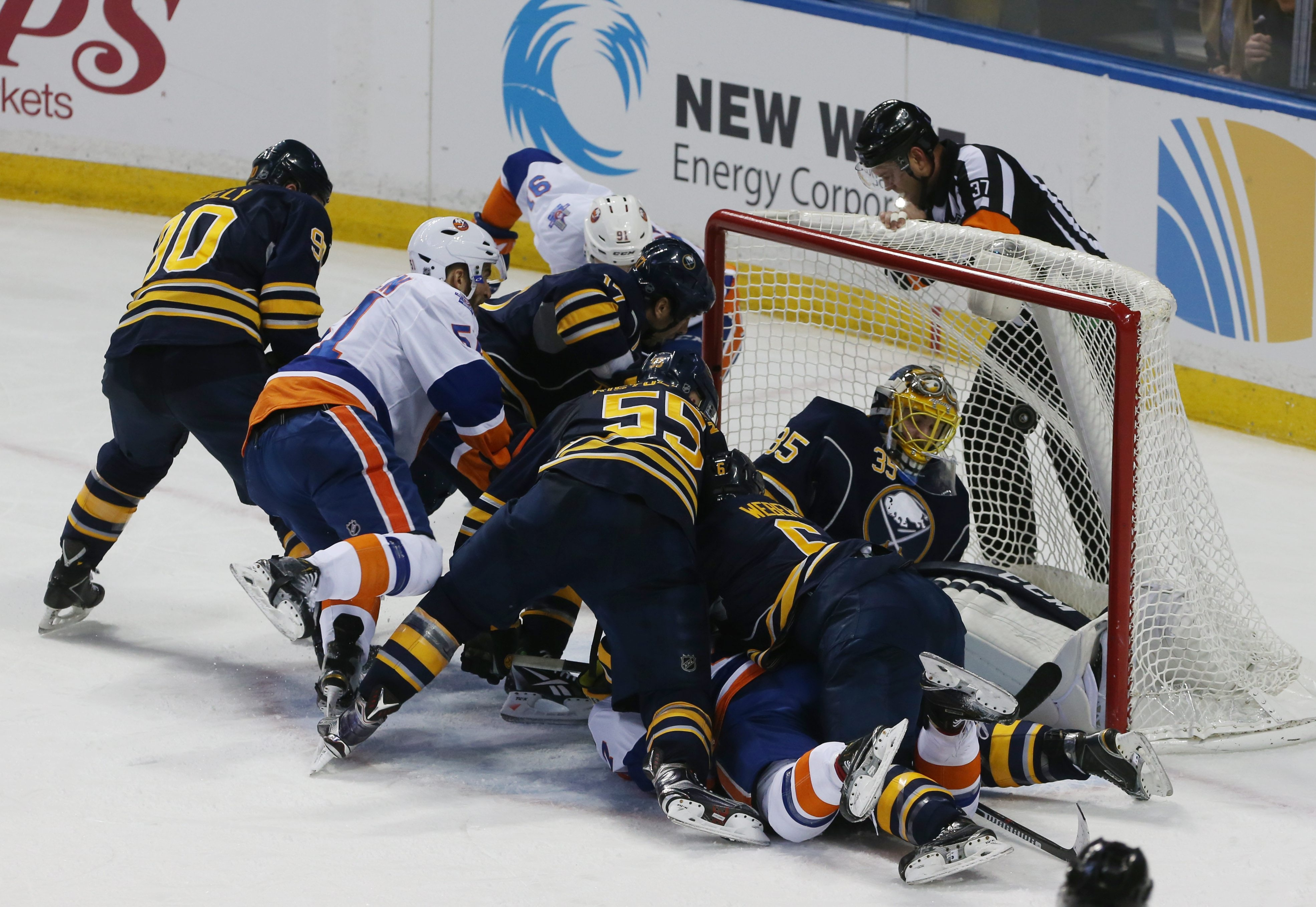 Frans Nielsen, left, scores the Islanders' first goal during a goal-mouth scramble in the second period against the Sabres' Linus Ullmark.