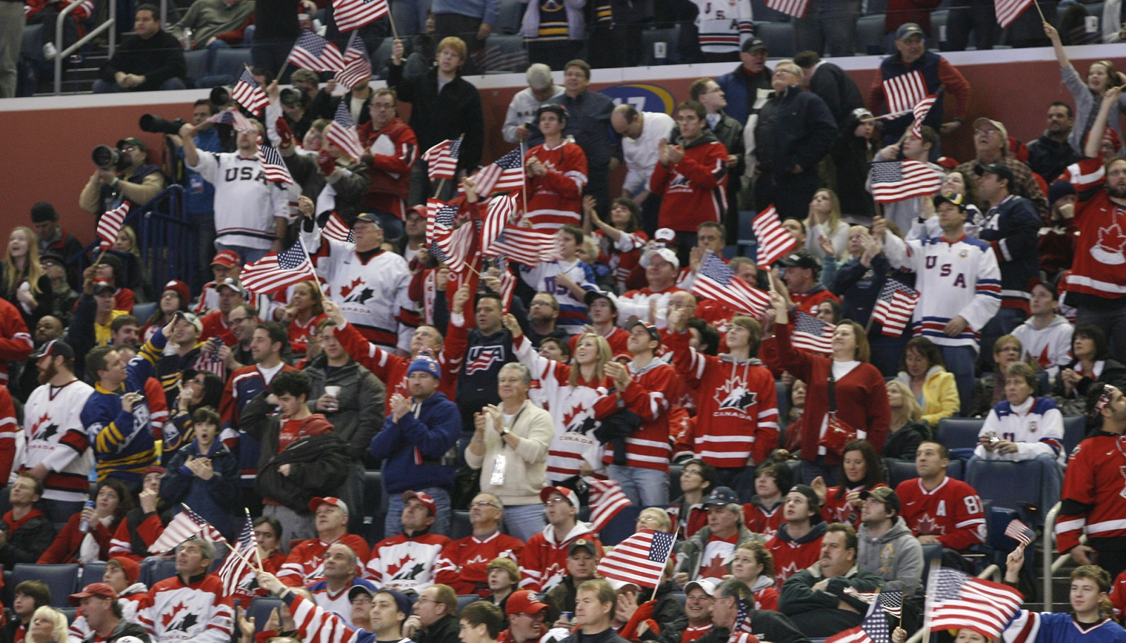 Hockey fans in Buffalo celebrate a third-period goal for the United States against Sweden during the 2011 World Junior Hockey Championships hosted at the First Niagara Center. (John Hickey/Buffalo News file photo)