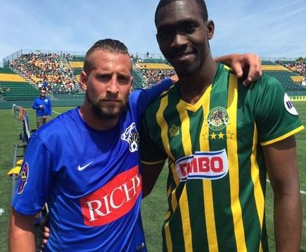 Chris Walter, left, poses with Rochester Rhinos USL Championship MVP Asani Samuels, a former FC Buffalo player. (via FC Buffalo)