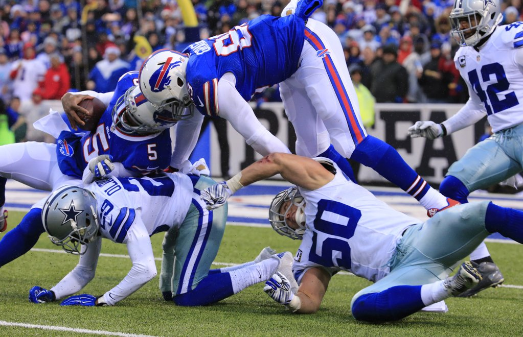 Tyrod Taylor fights for yards on the ground against the Cowboys. (Harry Scull Jr./Buffalo News)