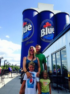 Family pic in front of blue cans