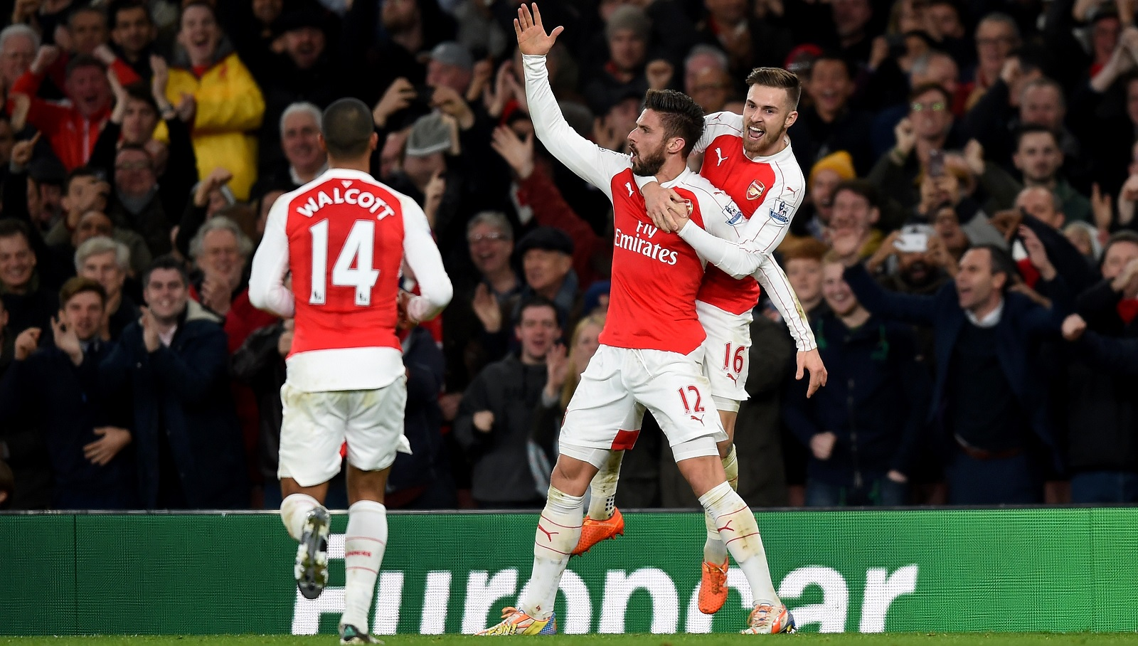 Olivier Giroud, middle, celebrates his goal for Arsenal with teammates Theo Walcott, left, and Aaron Ramsey. (Getty Images)