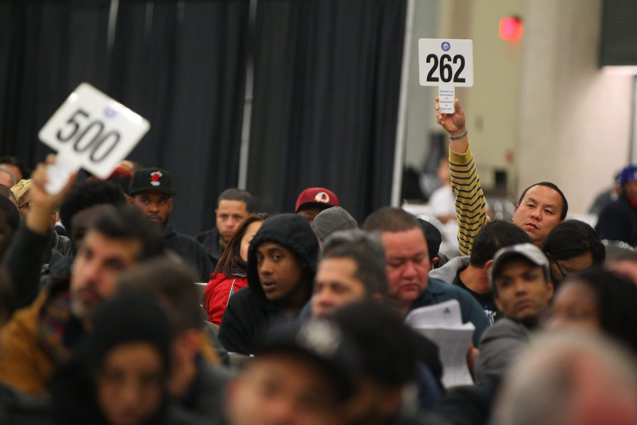 Bidders flock to city property auctions in the Buffalo Convention Center in search of what they hope will be good deals.   (Mark Mulville/Buffalo News file photo)