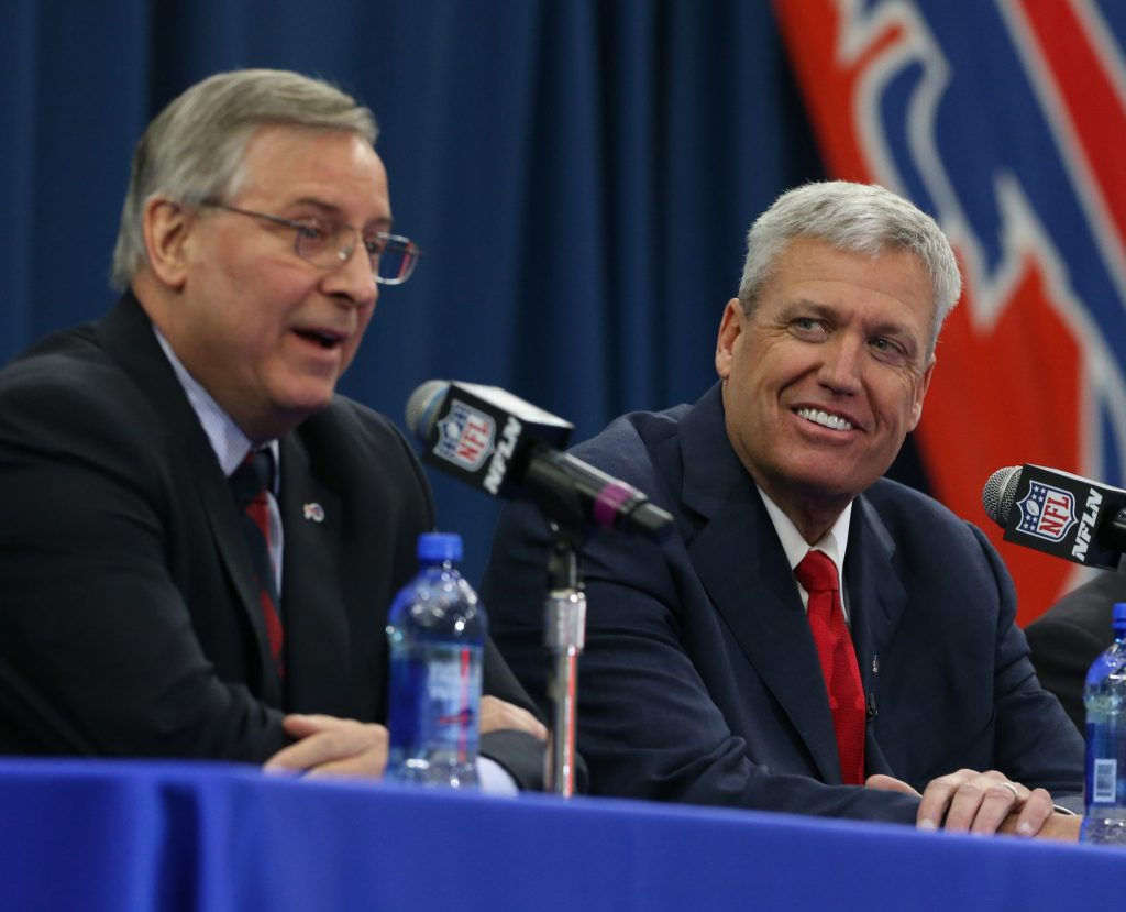 Terry Pegula announces Rex Ryan as the newest head coach of the Buffalo Bills during a press conference at the Ad Pro training center in Orchard Park on Jan. 14, 2015. (James P. McCoy/ Buffalo News)