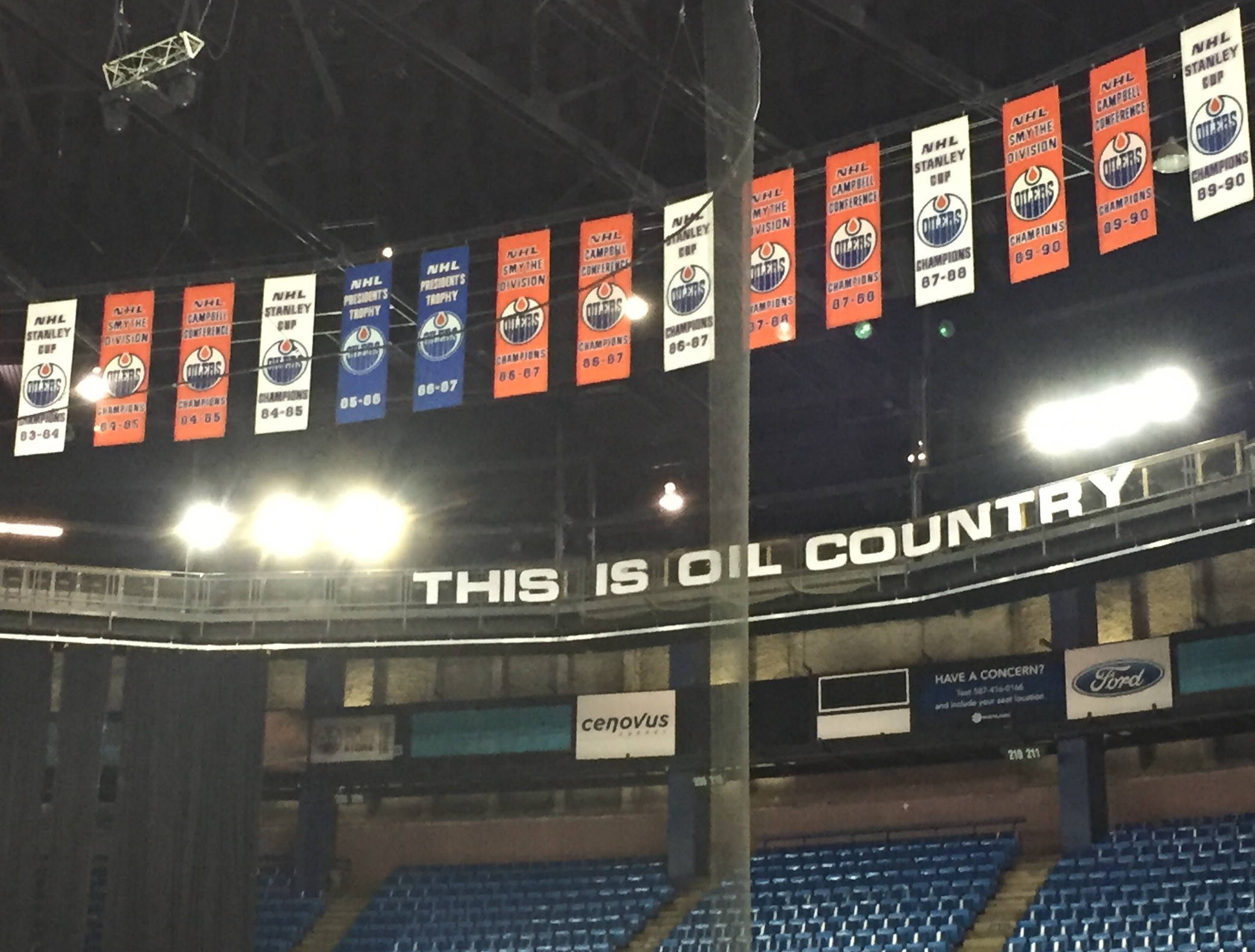 The Edmonton Oilers' five Stanley Cup banners are in white in the rafters of Rexall Place, which is in its final season as an NHL rink. (Mike Harrington/Buffalo News).