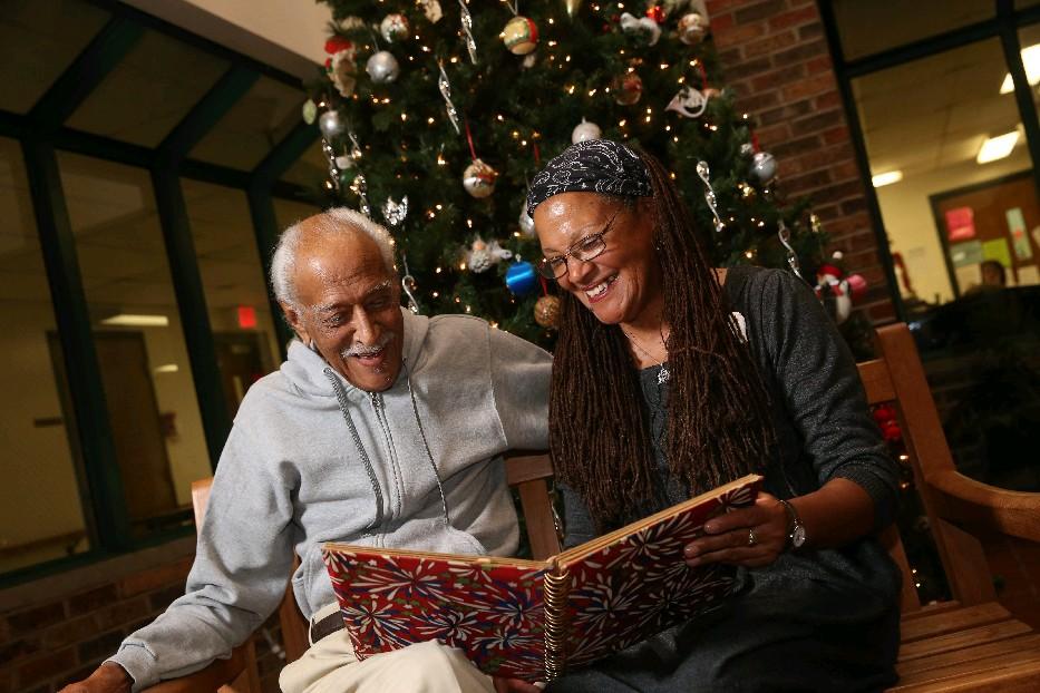 John Eaton, 91, and his daughter, Jacqueline Platt, enjoy remembering old times this week at Ridge View Manor in South Buffalo. (Sharon Cantillon/Buffalo News)