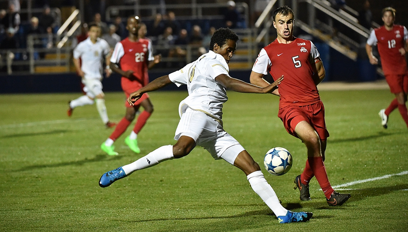 Ezana Kahsay, foreground in white, is a former International Prep soccer player who spent his high school years in Buffalo after moving as a refugee from Eritrea. Now, he plays for Akron, which is still alive in the 2015 NCAA Tournament. (Photo credit: Ernie Aranyosi)