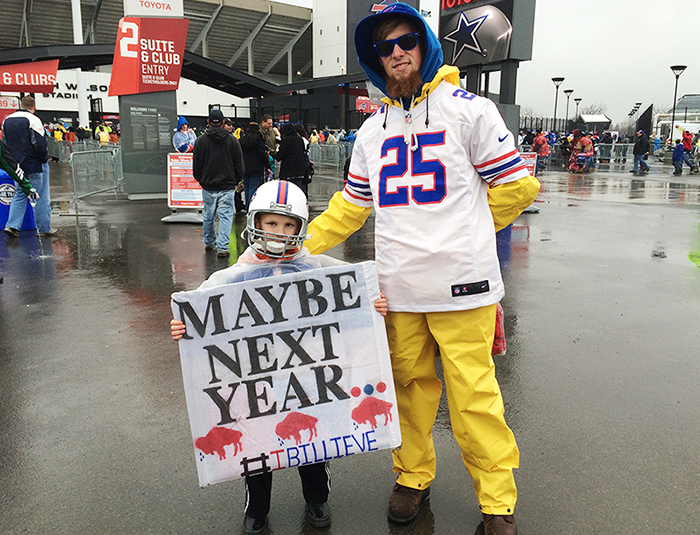 "Hunter Frenette, 7, holds a ""Maybe next year"" sign at his first regular-season Bills game. (Photos: Nick Veronica/Special to the News)"