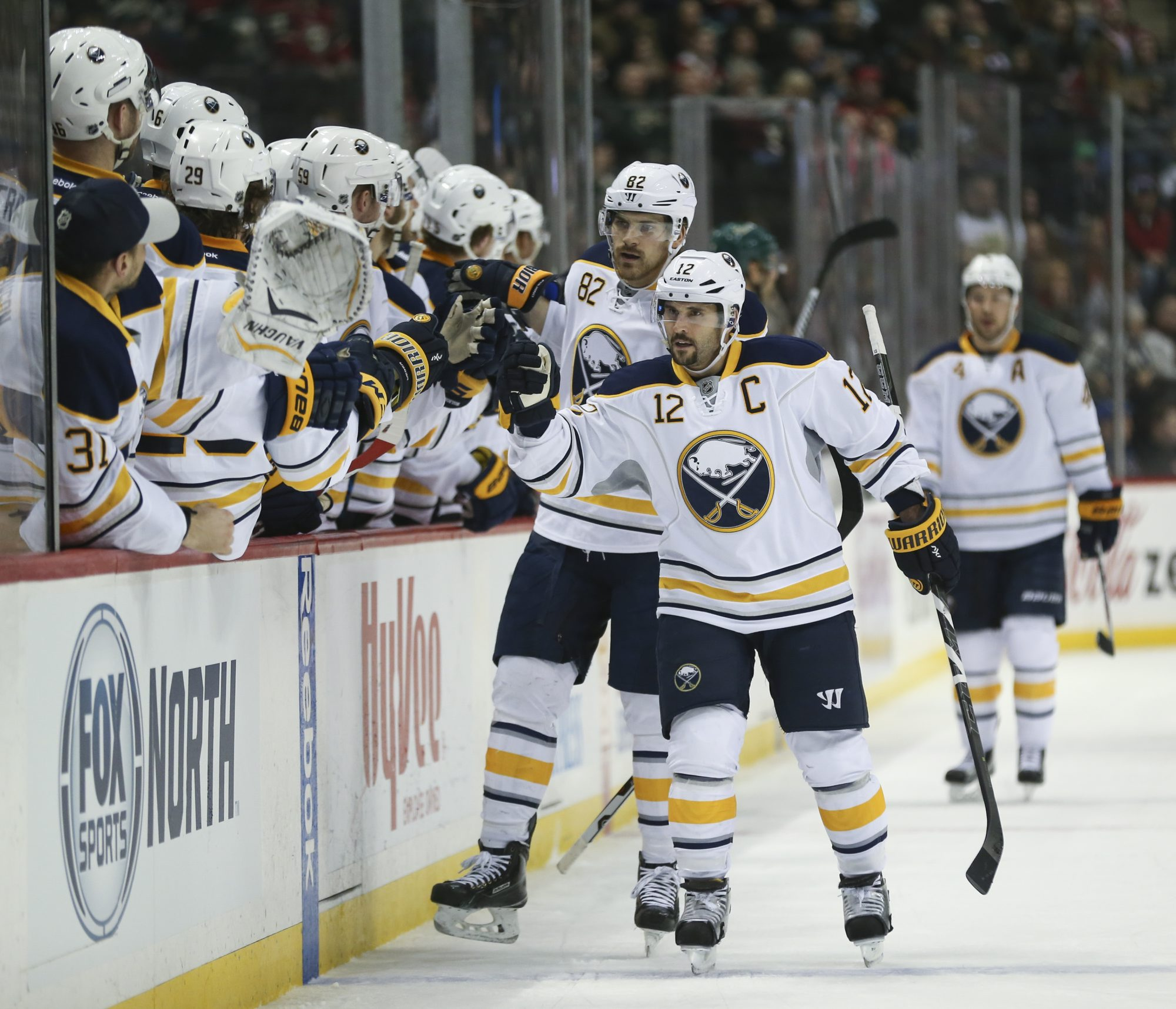 Buffalo Sabres right wing Brian Gionta (12) is congratulated by the bench after his first-period goal at Xcel Energy Center in St. Paul. (Jeff Wheeler/Star Tribune)