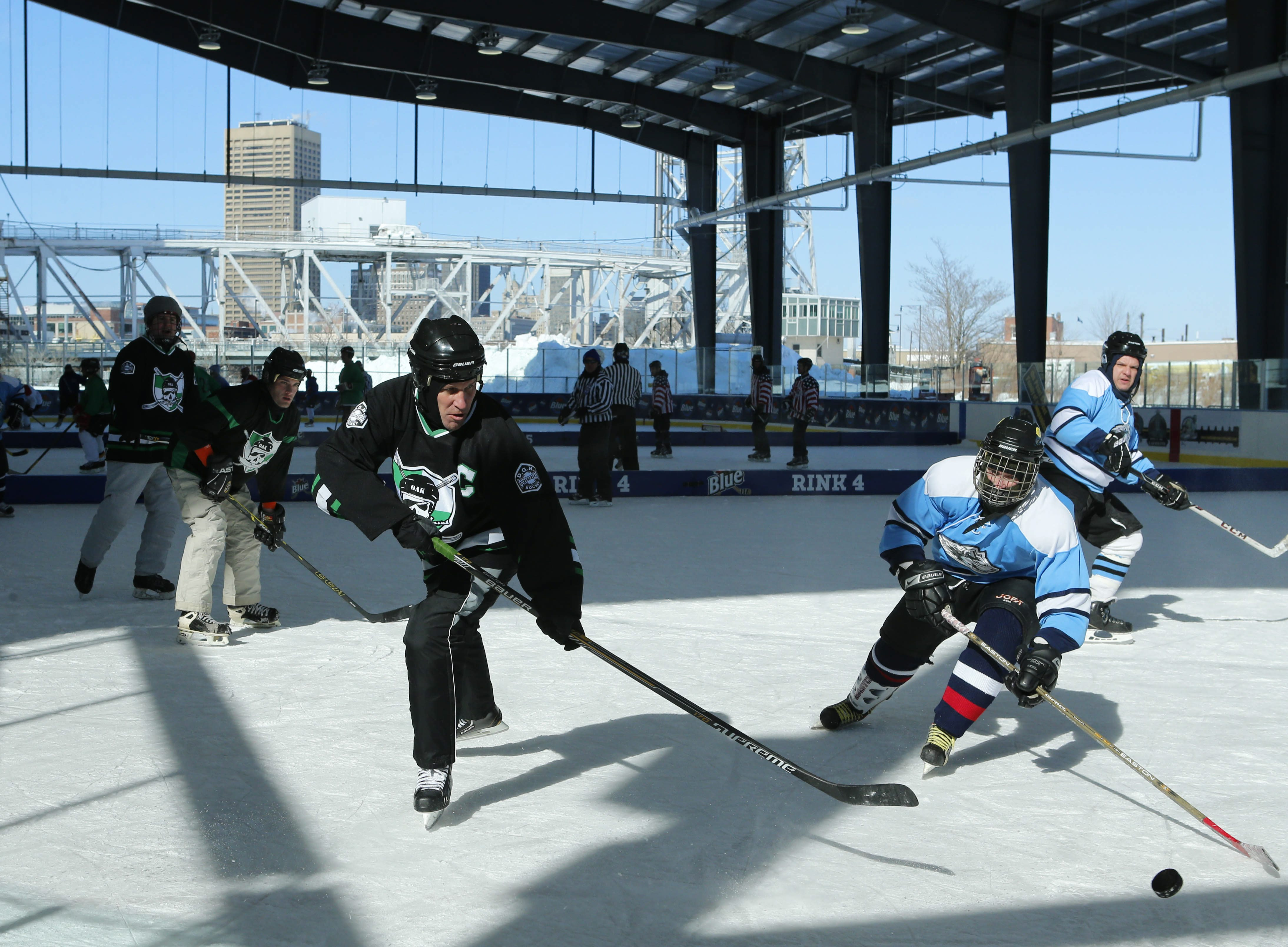 The Oakland Hitmen and the IceWolves-Cody compete during the 2015 Labatt Blue Buffalo Pond Hockey Tournament, also held at Buffalo RiverWorks. (Derek Gee/News file photo)