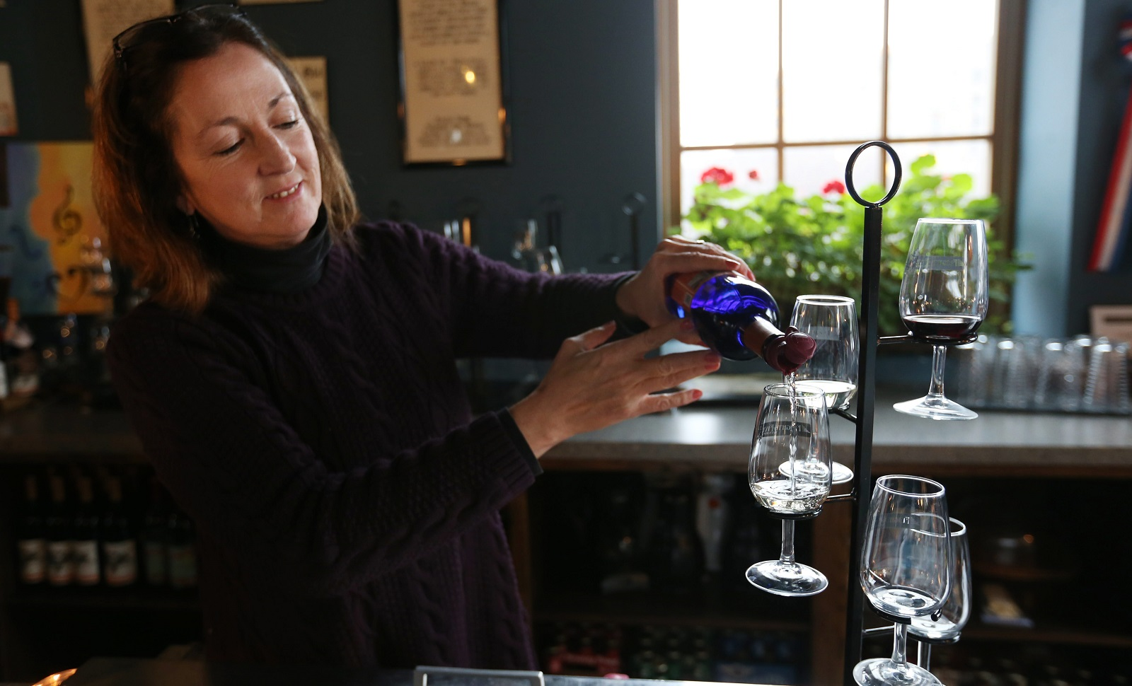 The Flight of Five Winery owner Jackie Connelly pours the Signature Flight of Five wines Lock 67-Lock 71. (Sharon Cantillon/Buffalo News file photo)