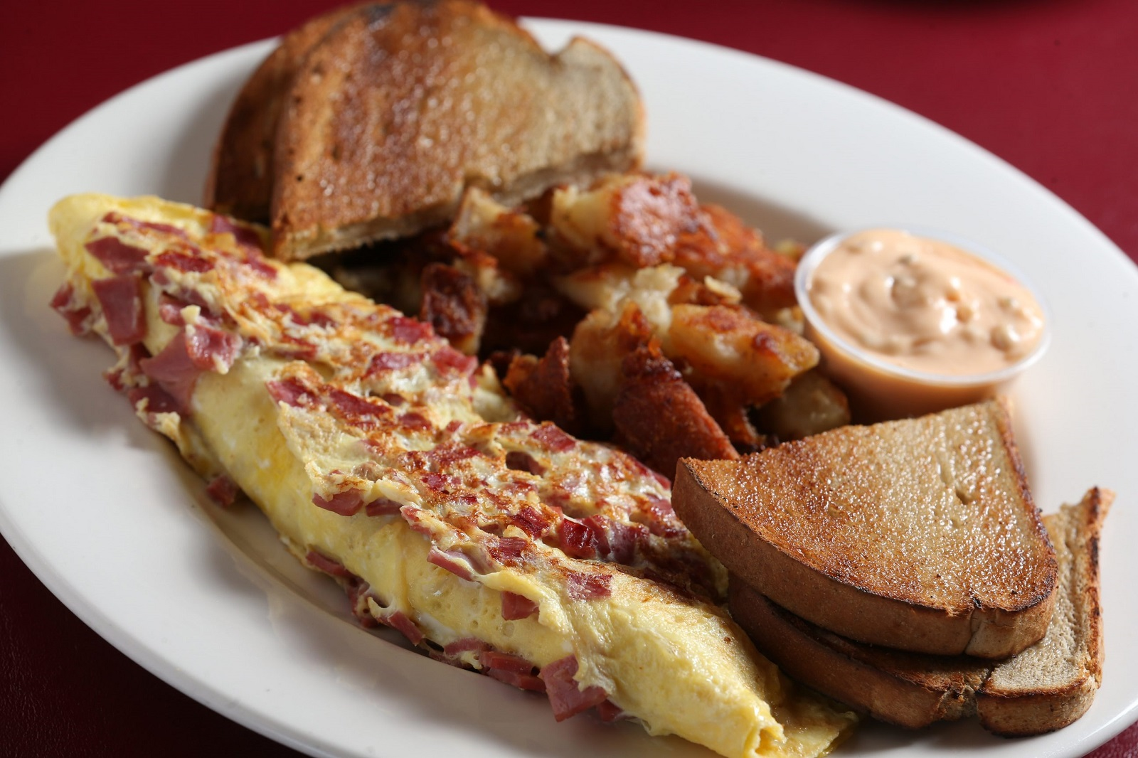 The Howling Rooster Cafe's the Roo-Ben Omelet, made with corned beef, sauerkraut, Swiss cheese and three extra large eggs. The restaurant will soon occupy the former Milano's. (Sharon Cantillon/Buffalo News)