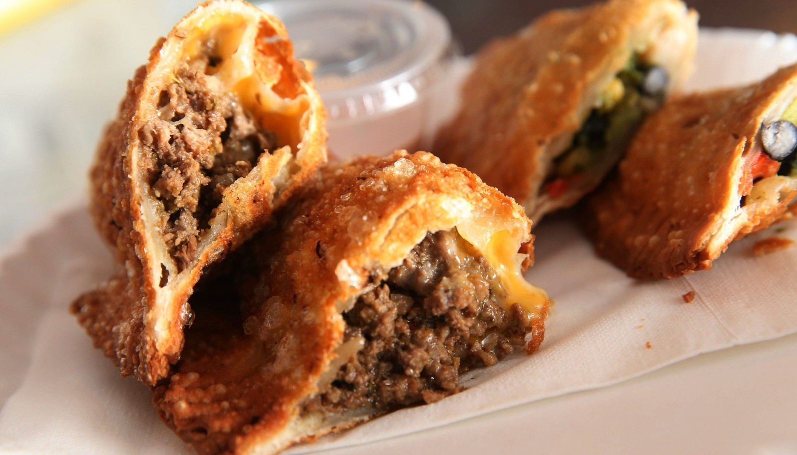 On the left is the beef and cheese empanada from La Gourmet Empanadas. (Sharon Cantillon/Buffalo News)