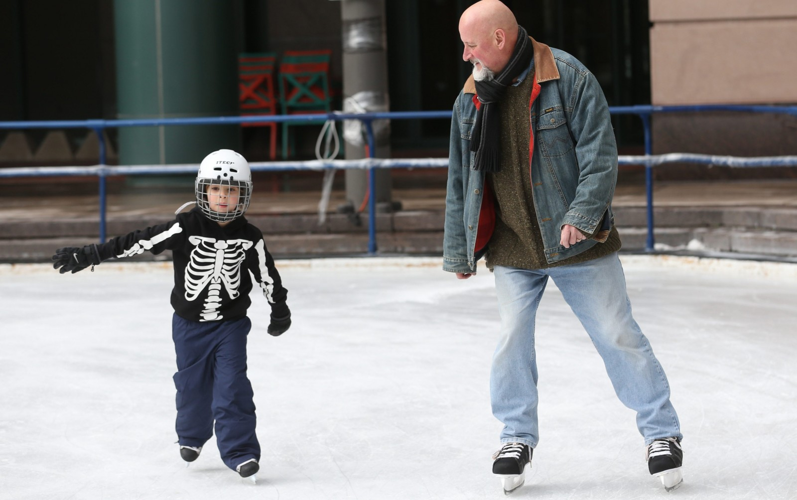 Jim Mezon of Niagara-On-The-Lake skates with his son Eli, 6, at Rotary Rink. (Sharon Cantillon/Buffalo News)