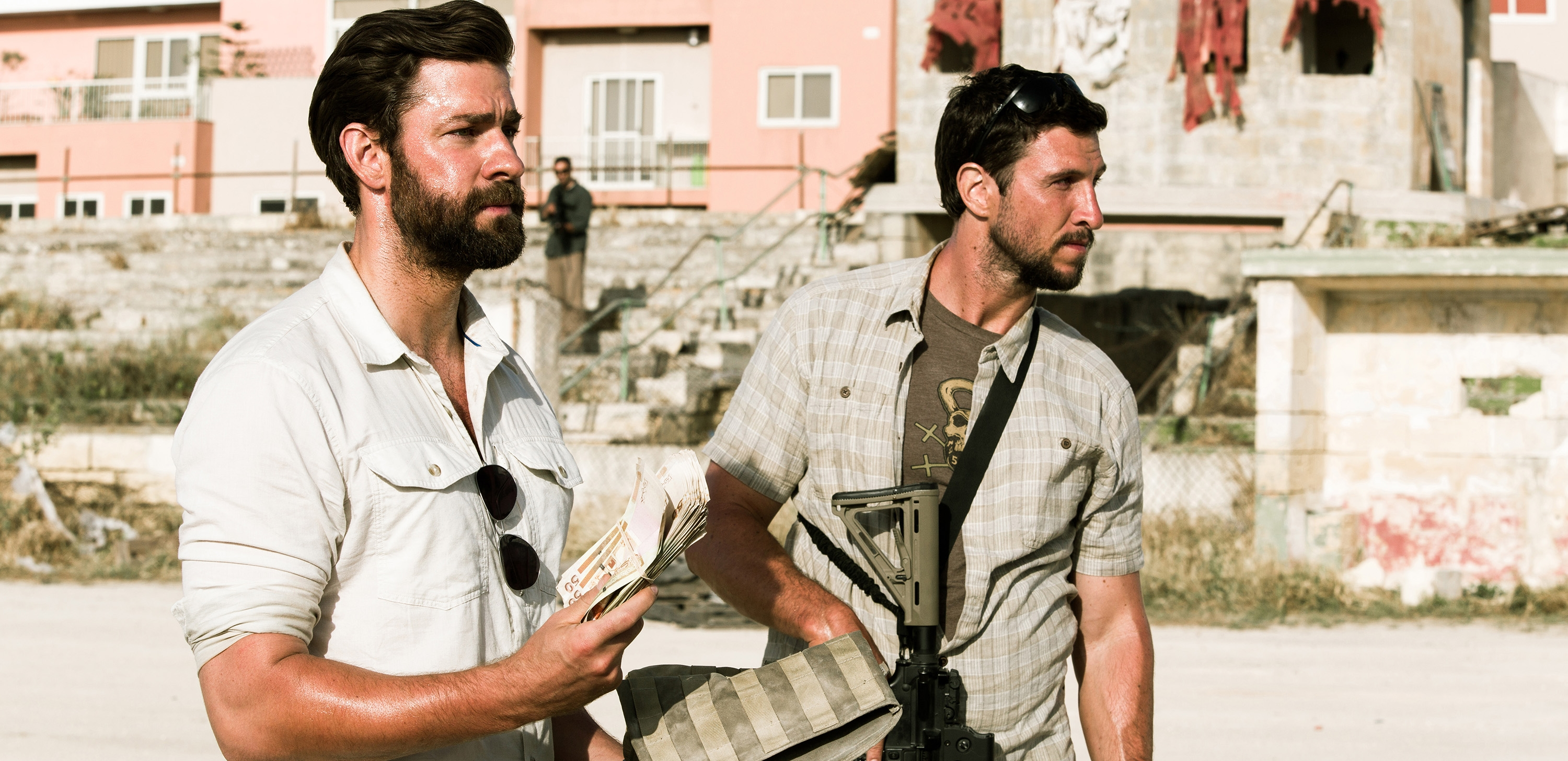 "John Krasinski, left, plays Jack Silva and Pablo Schreiber plays Kris ""Tanto"" Paronto in ""13 Hours: The Secret Soldiers of Benghazi."""