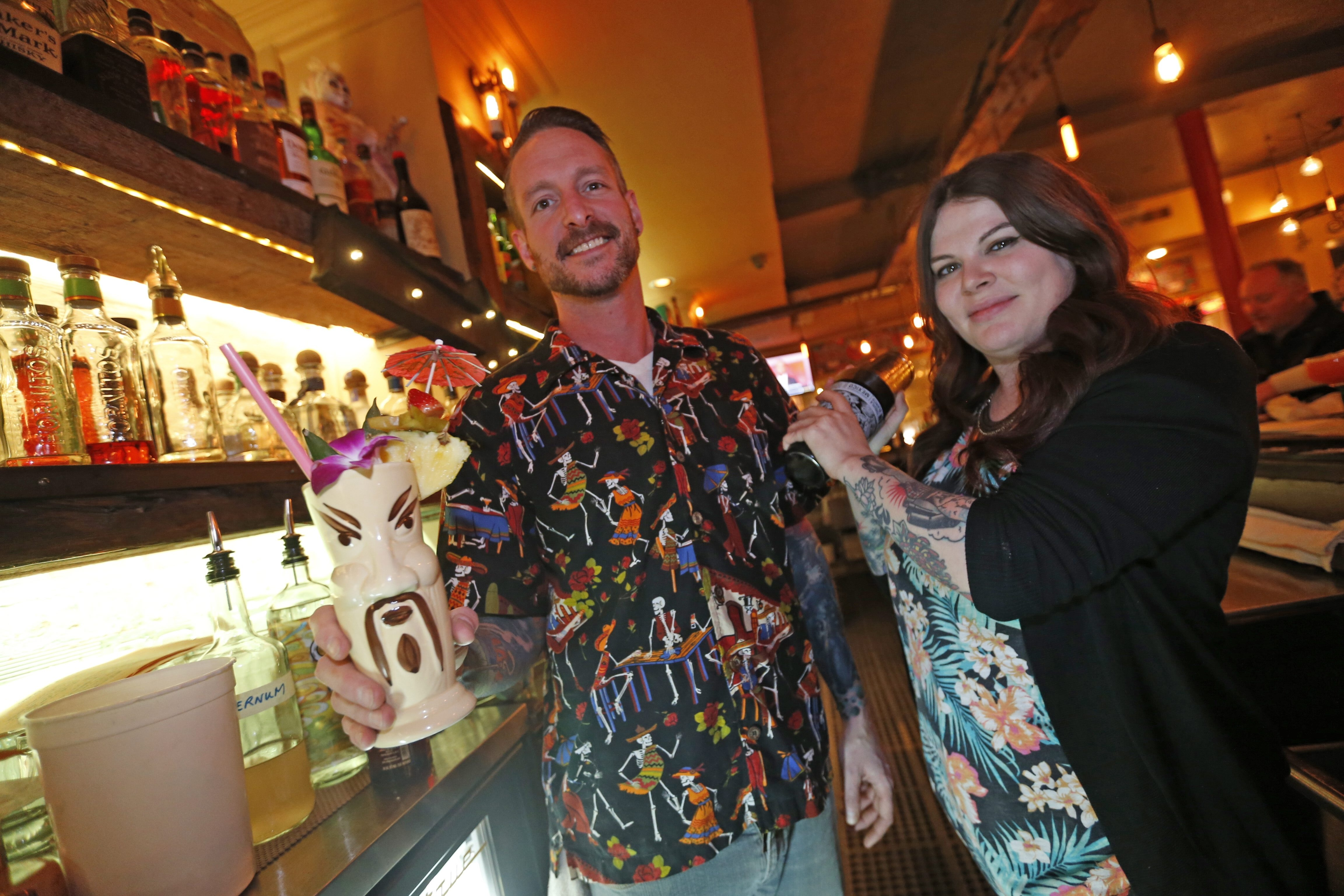 Manager Adam Smith and bartender Alison Clancy offer up some exotic drinks for CanTiki Tuesdays at Cantina Loco in Allentown. (Robert Kirkham/Buffalo News)