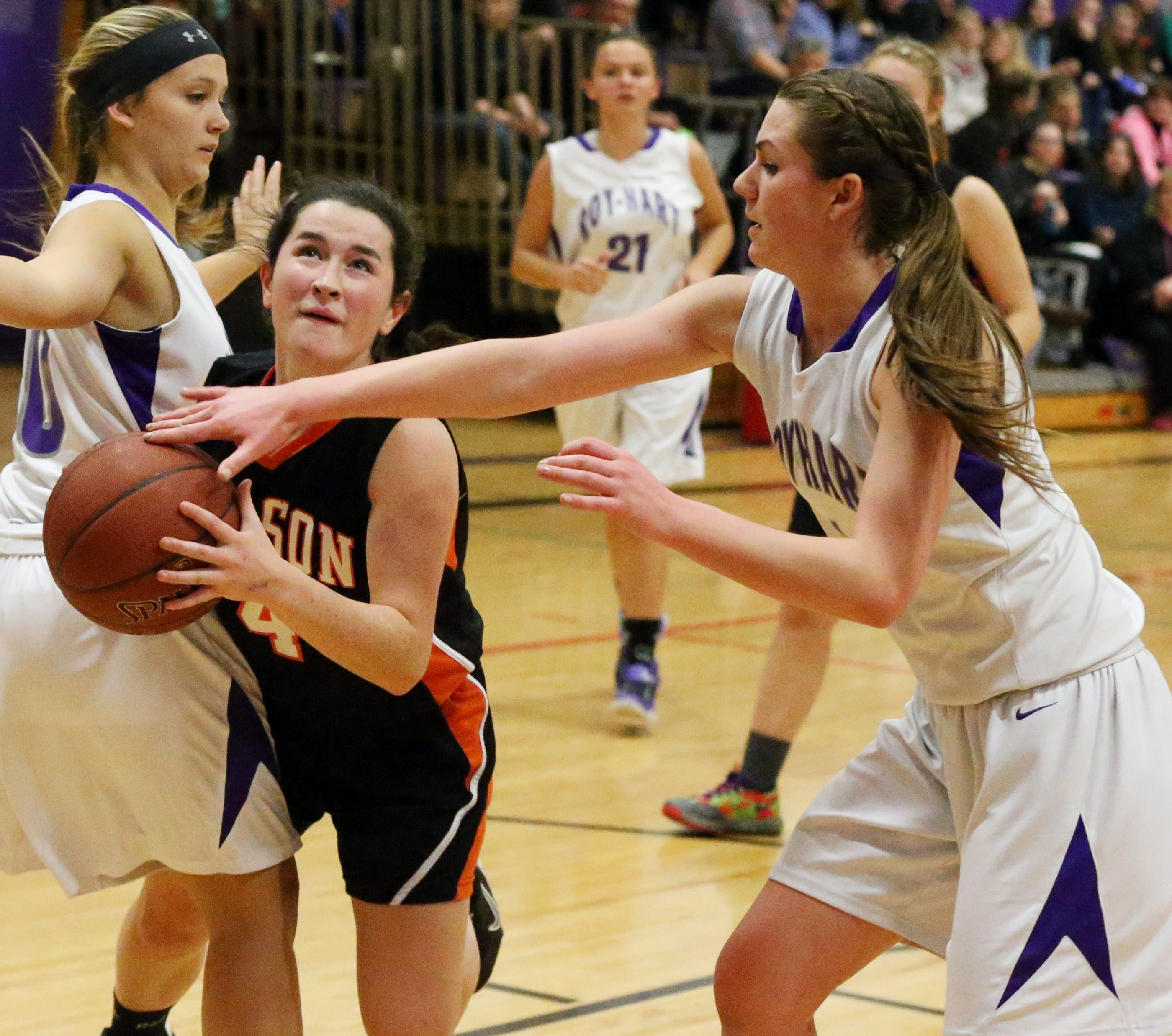 Emma Lindke of Roy-Hart, right, defends against Wilson's Jennifer Darlak during what would be the Wilson Lakewomen's 50th straight Niagara-Orleans victory.