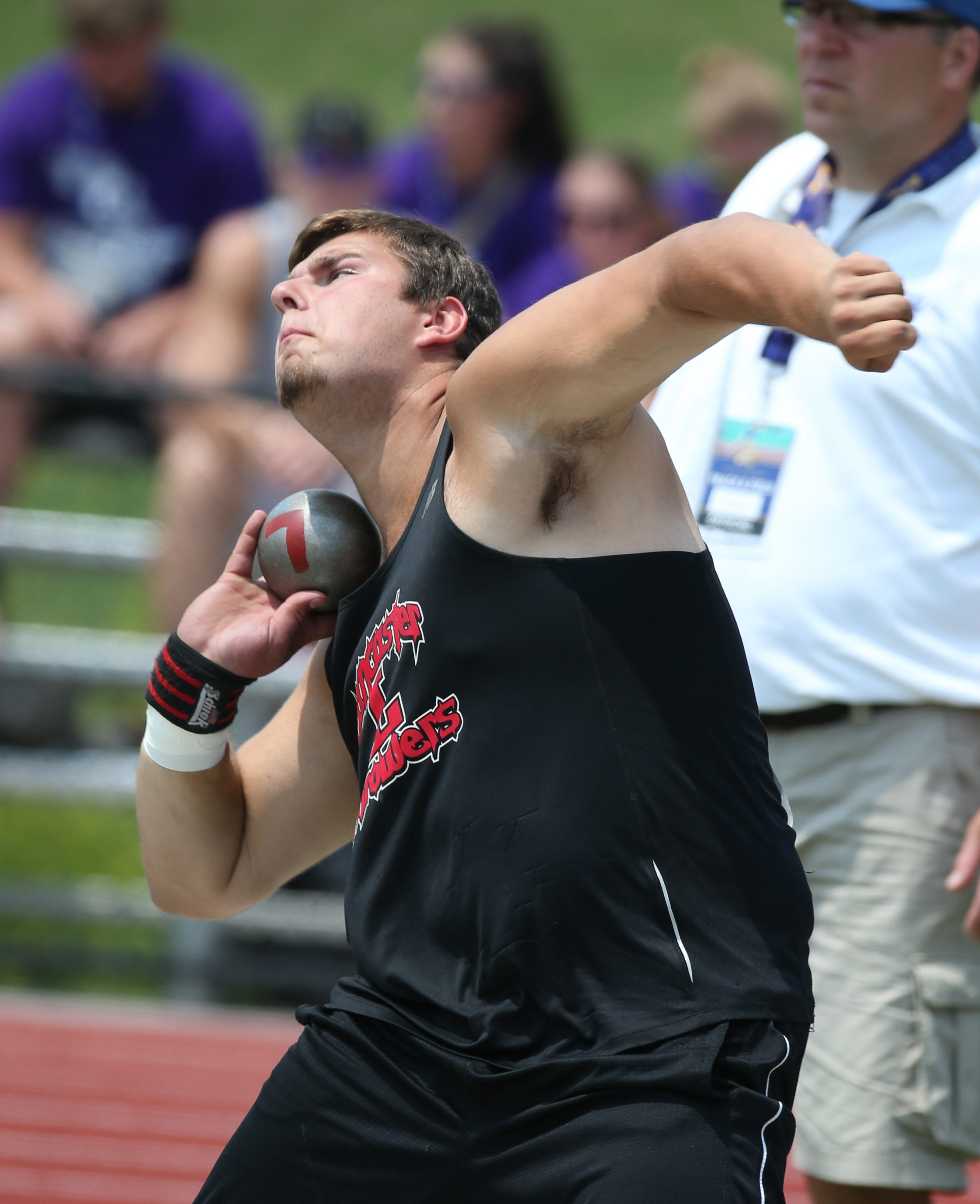 Lancaster's Colin Blair competes  in the shot put event during the New York State Track & Field Championship at the University of Albany.