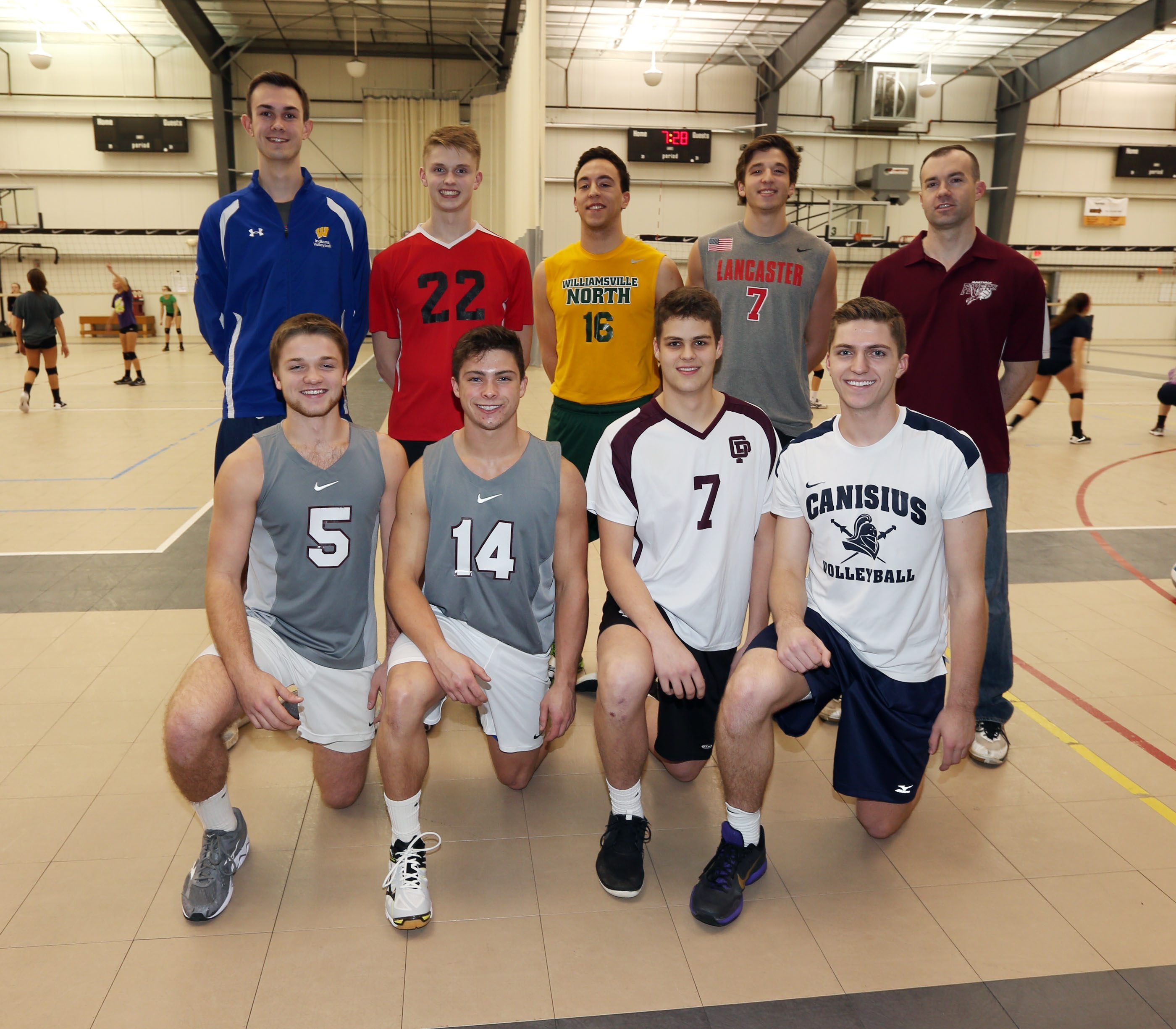 The All-WNY boys volleyball first team. Front row, left to right: Calvin Nowicki (Eden), Declan Pierce (Eden), Jason Manley (Orchard Park),  Griffin Schmit (Canisius). Back row, Cam Bartus (West Seneca West), Henry Payne (Clarence), Noah Chojnacki (Williamsville North), Jay Baumann (Lancaster) and Coach of the Year Andy Murtha (Maryvale).