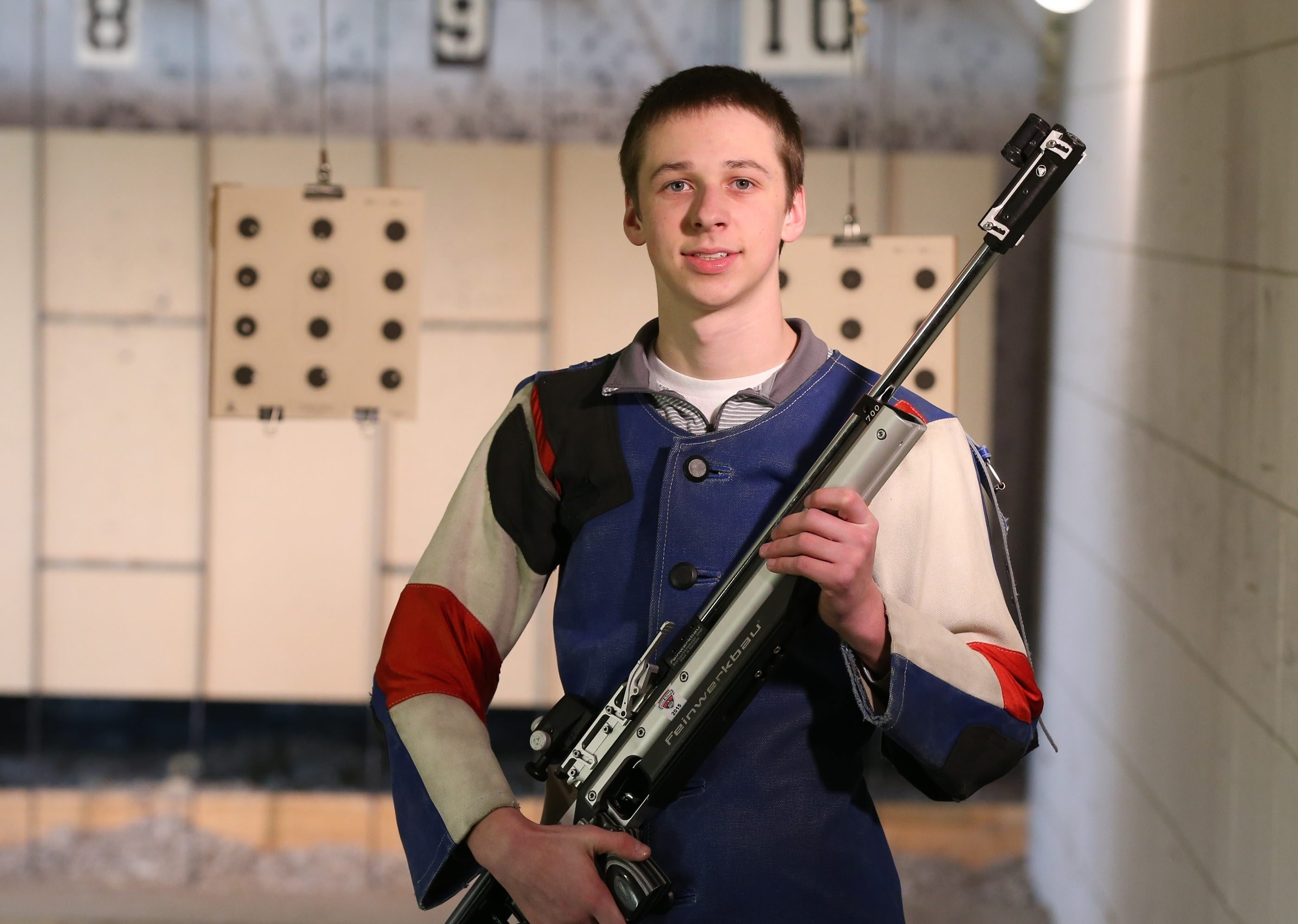 Alden's Noah Fox poses with his rifle in the shooting range at Alden Middle School. (James P. McCoy/ Buffalo News)