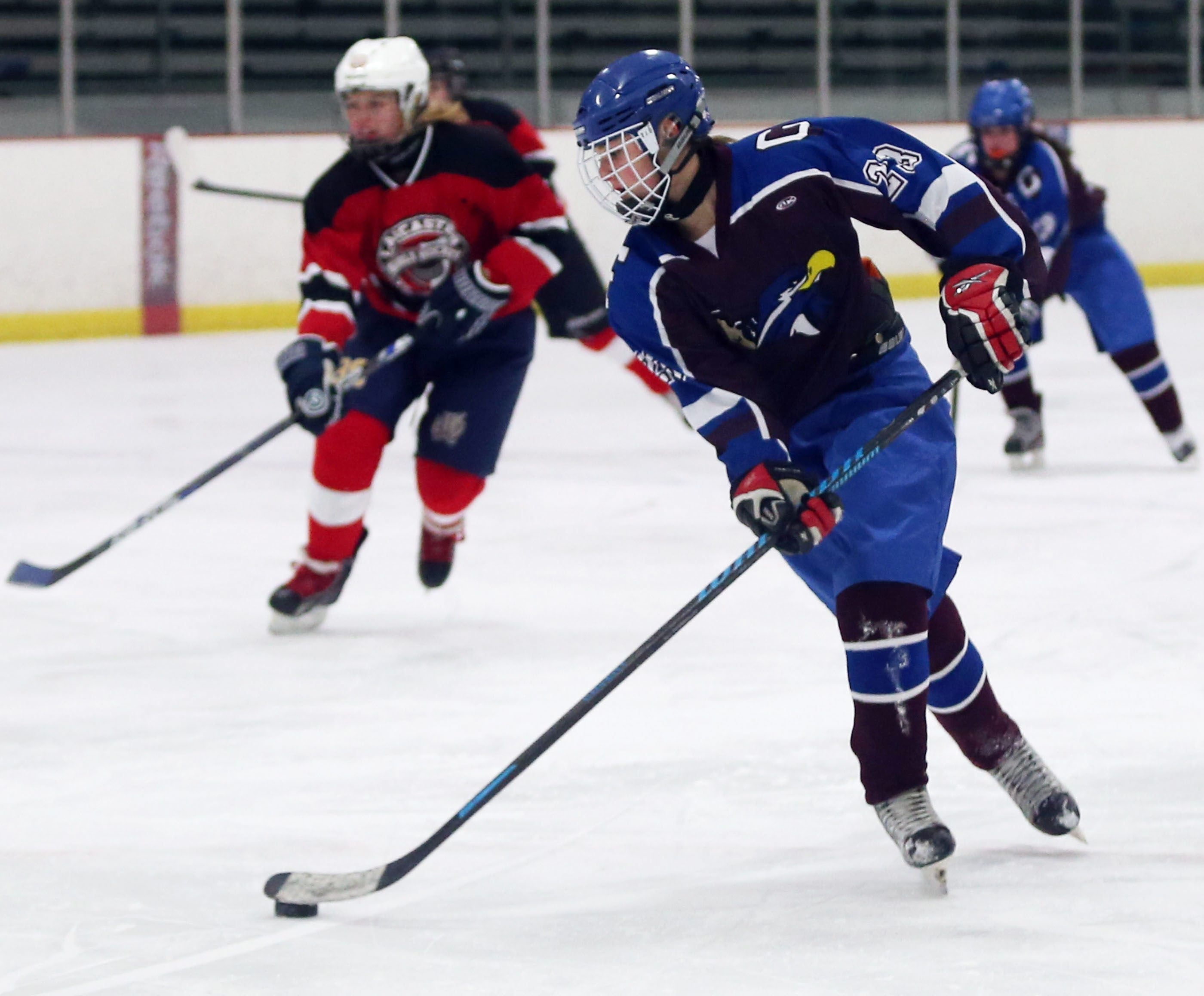 Orchard Park/Frontier's Haley Tatar scores a goal in a 6-0 triumph over Lancaster/Iroquois at Holiday Twin Rink  in Depew.