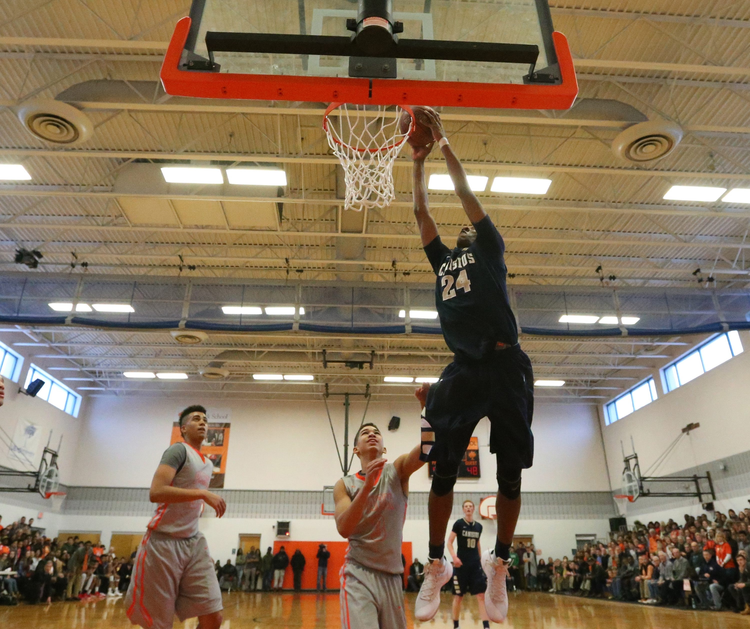 Senior forward Stafford Trueheart strikes for two points while leading Canisius to a 56-53 victory over Park in a battle between reigning New York State Federation champions at Park School.