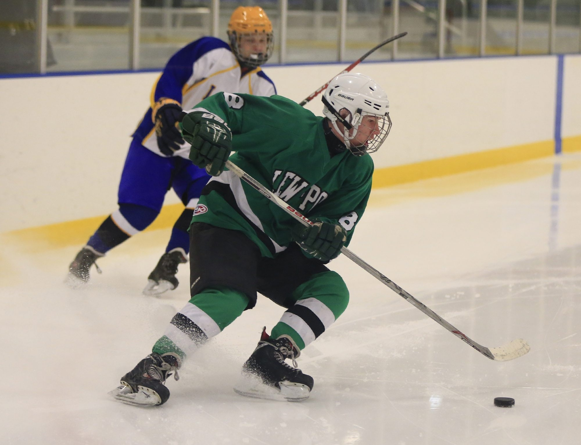 Braden Regis moves the puck on offense against Lockport during Thursday's game at Hyde Park. He finished with three goals to lead Lewiston-Porter to victory.