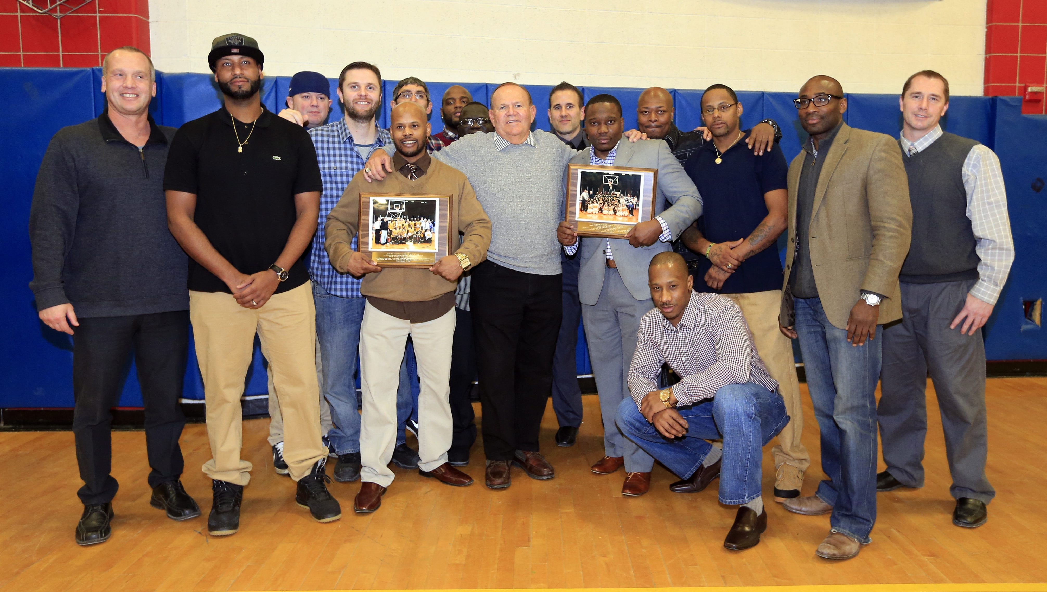 Coaches and players from the 1994-95 and 1995-96 state championship teams are honored at Niagara Falls high school on Friday, Jan. 29, 2016.  ()
